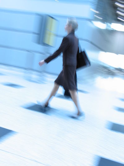 Business woman in a hurry Adult Adults Only Blurred Motion Business Business Person Business Woman On The Move City Day Full Length In A Hurry  Motion One Person One Woman Only Outdoors People Physical Activity Rush Hour Speed Street Woman