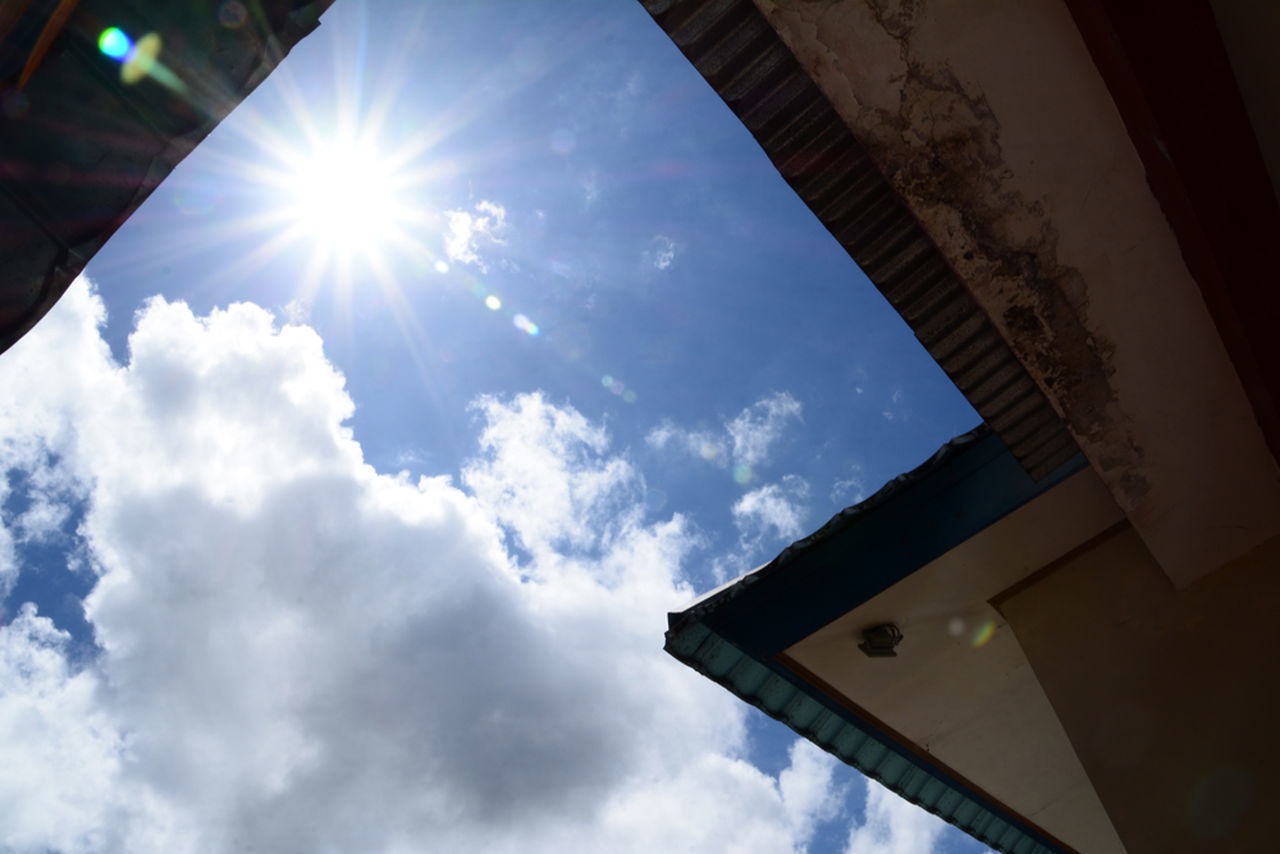 low angle view, sunbeam, sun, sky, sunlight, lens flare, cloud - sky, day, no people, nature, built structure, outdoors, beauty in nature, architecture