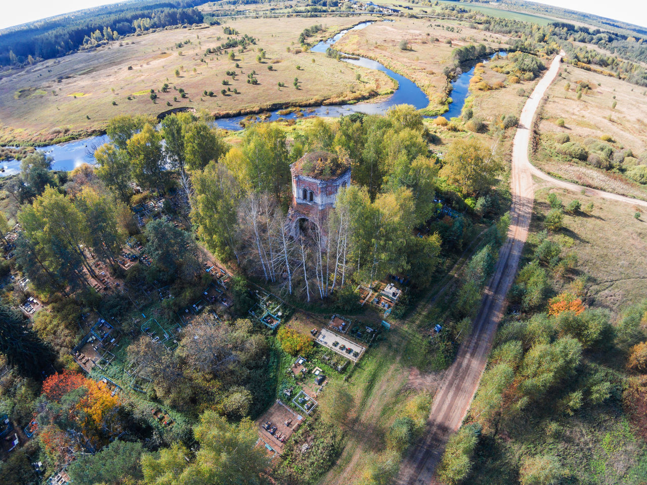 """Aerial view of an abandoned church and cemetery near the river Volchina. From the series """"Flying in the hamlet Lunacharsky."""" A Bird's Eye View Abandoned Abandoned Church Aerial View Beauty In Nature Cemetery Day Drone  Dronephotography Farm Green Color High Angle View Landscape Nature Nature No People Outdoors River Top Perspective"""
