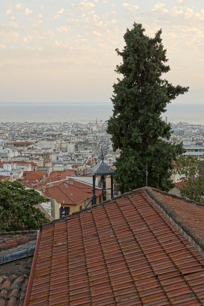 Thessaloniki at your feet! Church Old Town Place Of Worship Thessaloniki Tree Architecture Building Exterior Built Structure City Cityscape Day Horizon Over Water Nature No People Outdoors Roof Sea Sky Tiled Roof  Tree Urban Urban Scenery Viewpoint Water Waterfront