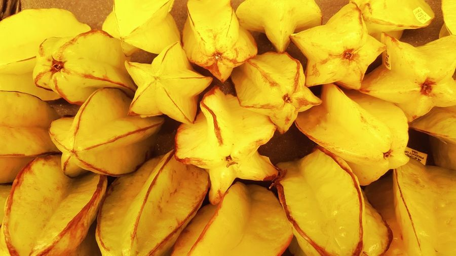 Yummy Starfruit, picture perfect Abundance Backgrounds Carambola Close-up Detail Focus On Foreground Fragility Freshness Natural Pattern No People Organic Produce Star Fruit  Variation Yellow Fruit