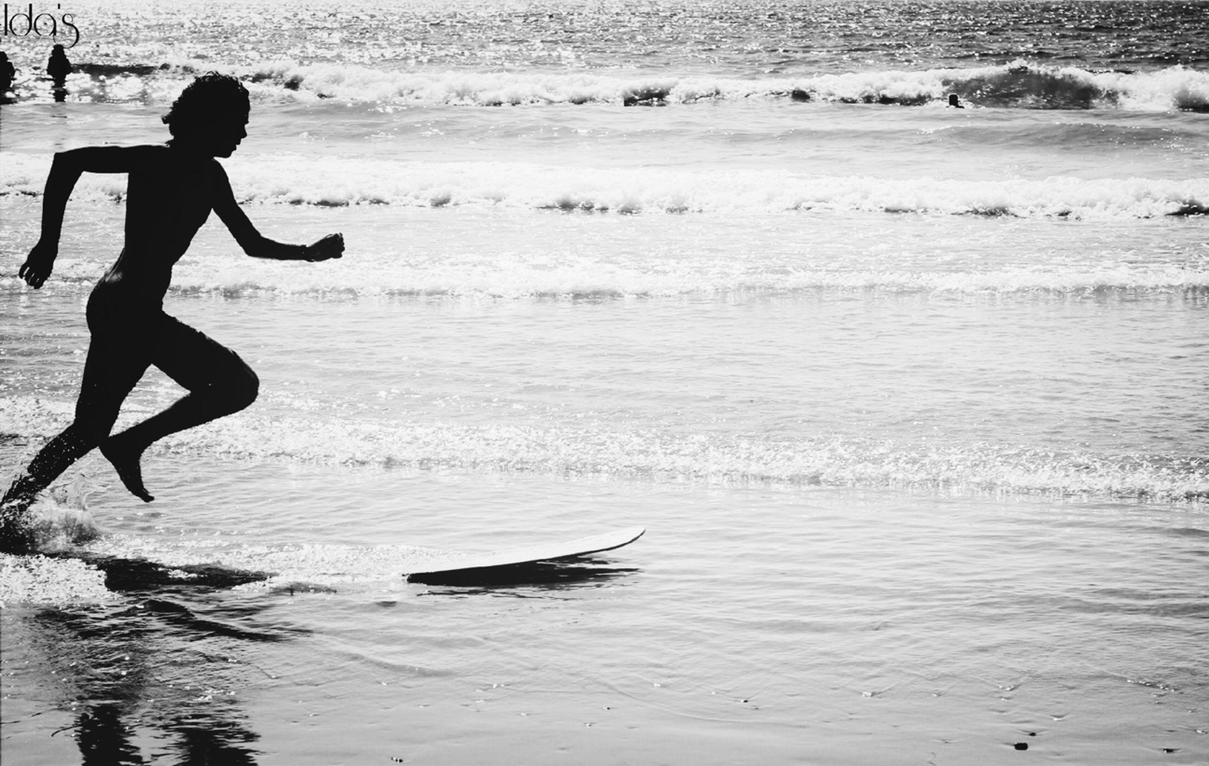 lifestyles, leisure activity, water, full length, men, beach, sea, enjoyment, jumping, vacations, surfboard, wave, childhood, shore, fun, boys, sport