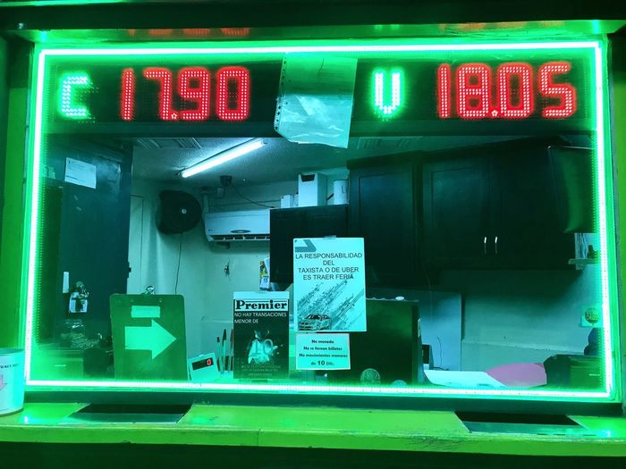 The exchange rate currently in Mexico is 17.90 pesos for each US dollar. Text Communication Green Color No People Guidance Illuminated Neon Technology Night Outdoors Time Close-up Mexico Mexicali Baja California Exchange Rate Pesos
