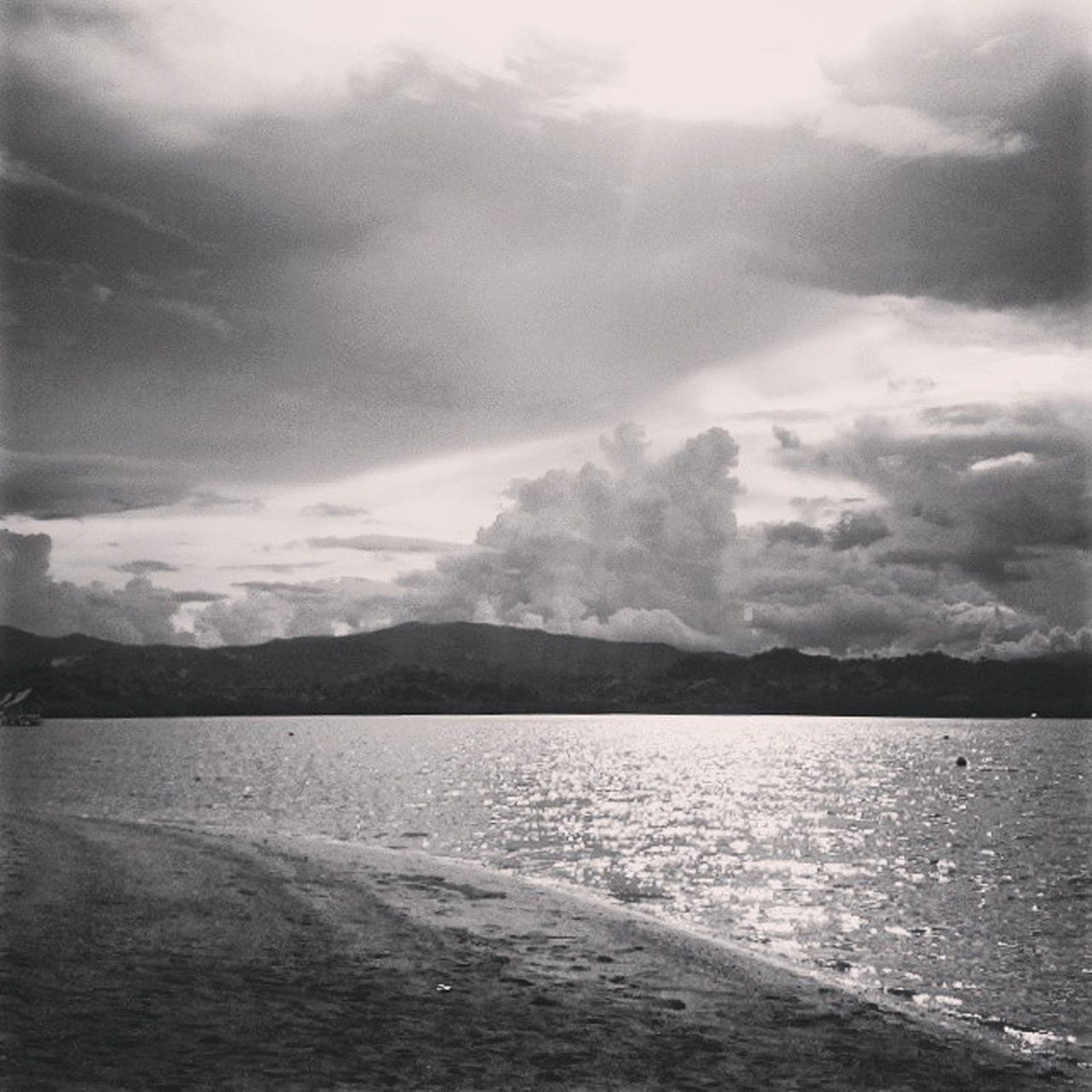 water, sky, sea, tranquil scene, scenics, tranquility, beauty in nature, beach, cloud - sky, nature, shore, cloudy, cloud, mountain, sand, idyllic, outdoors, coastline, sunlight, non-urban scene