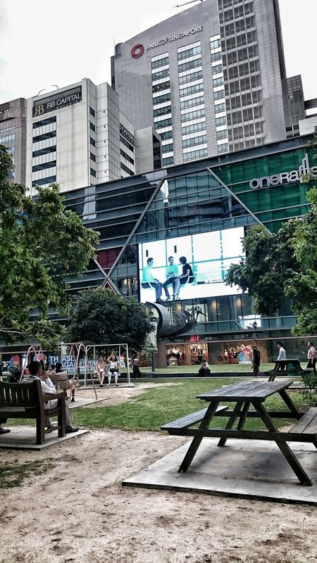Picnic haven in the midst of skyscraper forest.... City Architecture Built Structure Building Exterior Outdoors Cbdsingapore Cbd Life Central Business District Swings Picnic Table Business Finance And Industry Streetphotography Streetviews Buildings GreenScenes Adapted To The City