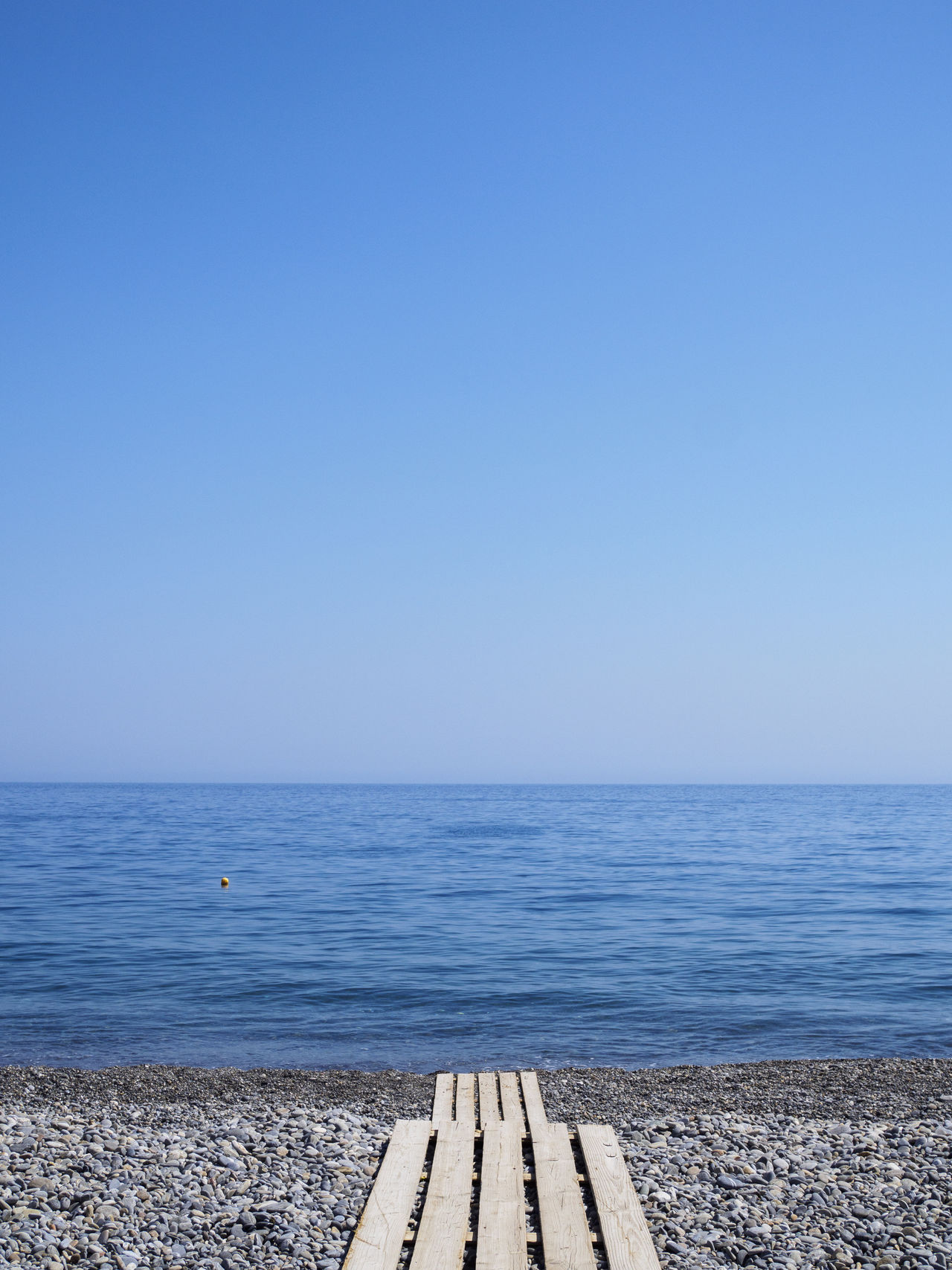 Sougia beach on the south side of Crete Beach Blue Clear Sky Holiday Horizon Over Water Idyllic Minimalism No People Pebble Beach Sea Tranquil Scene Tranquility Vacations Walkway Water