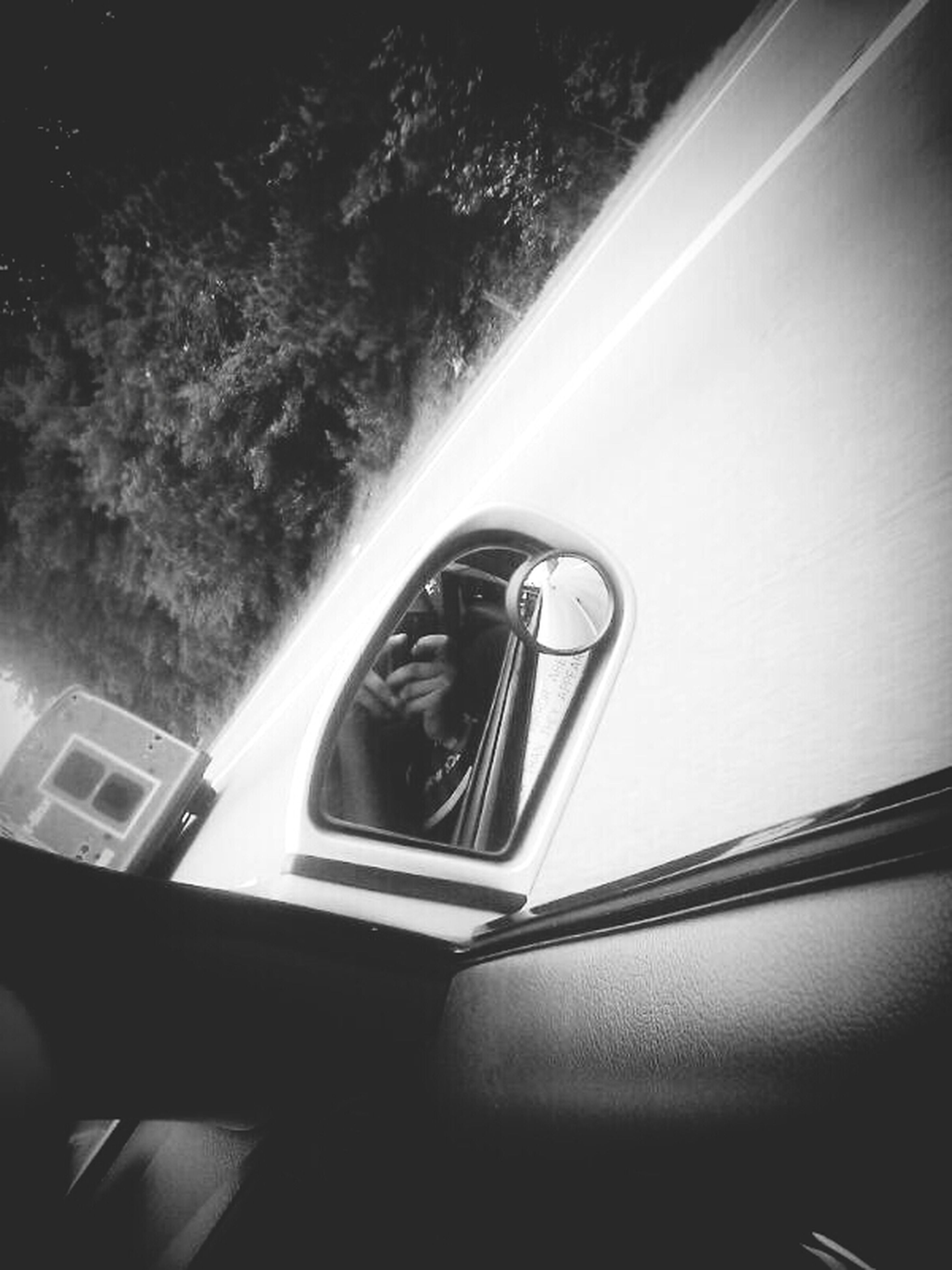 transportation, mode of transport, land vehicle, car, part of, cropped, reflection, glass - material, no people, close-up, window, day, side-view mirror, on the move, high angle view, outdoors, road, travel, vehicle interior, sunlight