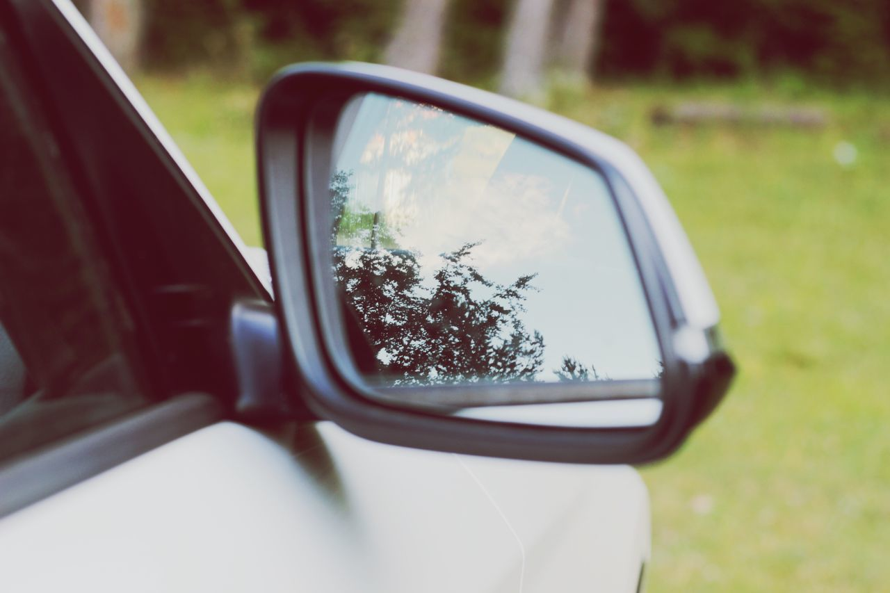 EyeEm Selects EyeEmNewHere Car Side-view Mirror Land Vehicle Mode Of Transport Transportation Reflection Vehicle Mirror Day Road Speed No People Road Trip Motion Close-up Tree Outdoors