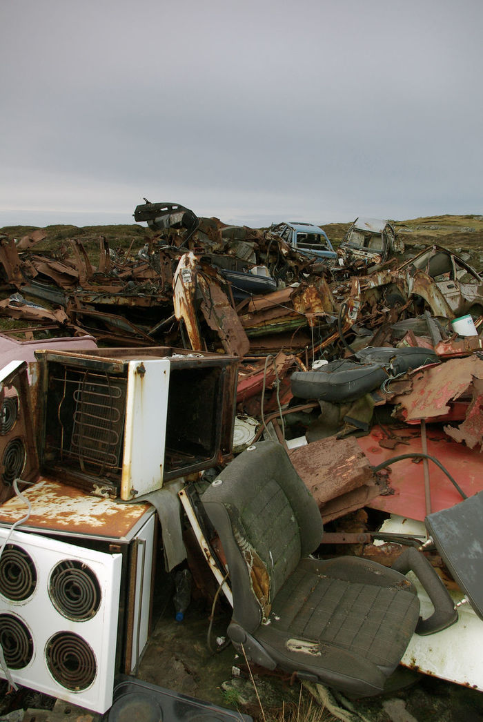 Scrap Abandoned Large Group Of Objects Outdoors Waste Management Fly Tipping. Illegal Dumping junk Rural Scene Isle of Lewis, Outer Hebrides.
