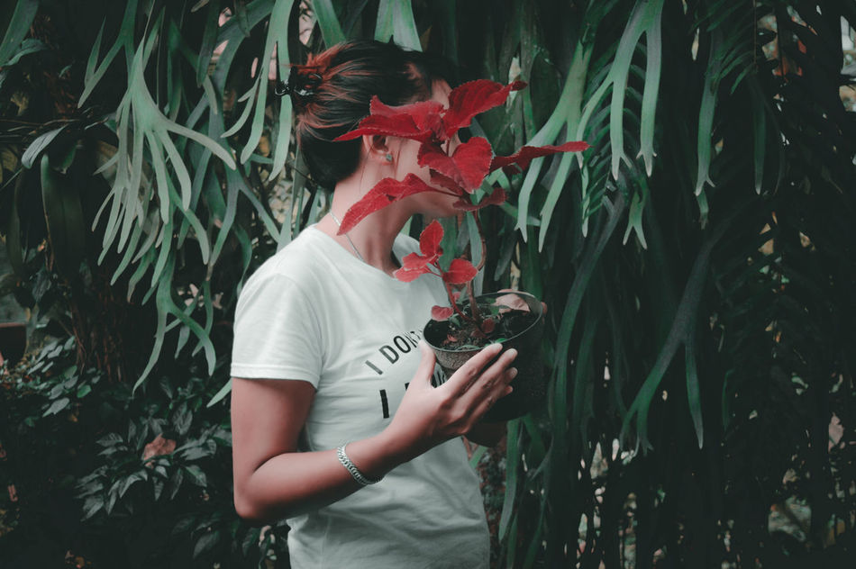 Break The Mold TCPM Girl One Woman Only One Person Individuality Outdoors Day Growing Up Growing Growth Nature First Eyeem Photo Softness EyeEm Indonesia Beauty In Nature Girl Art Is Everywhere Streetphotography Plant Flower