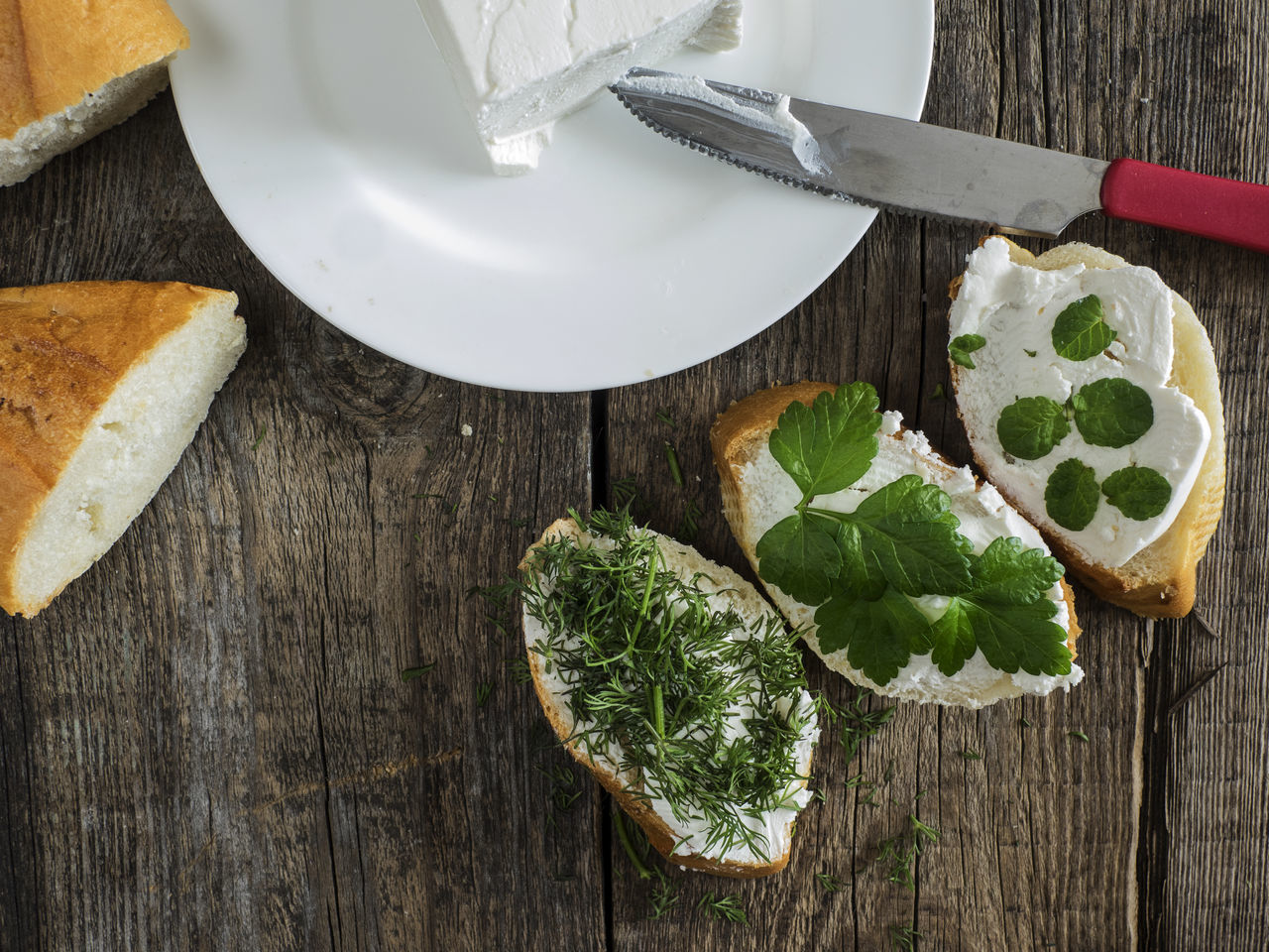 bruschetta with feta cheese and chopped spicy herbs on an old wooden weathered table Background Bread Bruschetta Cheese Chopped Feta Food Freshness Green Color Healthy Eating Herbs No People Old Planks Spicy Table Weathered Wood - Material Wooden