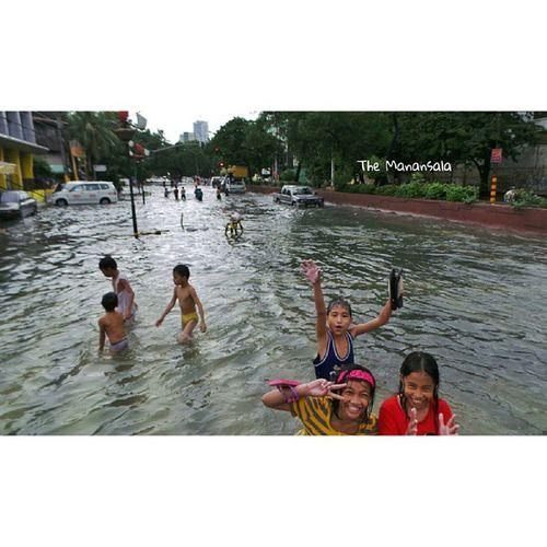 MaringPH Children swim on flooded street of Quirino Avenue in Manila NagbaBandila Themanansala Photography photojournalism monsoonrains manila streetfloods @youscoop
