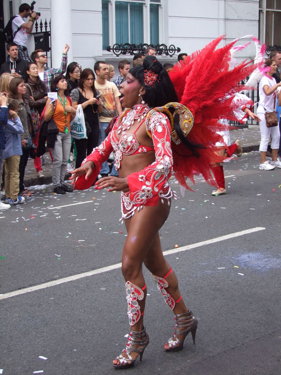 Nottinghill Carnival 2012 Carnival City Composition Costume Dancing Feathers Festival Full Frame Full Length Fun GB Happiness Incidental People Leisure Activity Lifestyles London Nottinghill Carnival Outdoor Photography Red And Silver Singing Standing Tourist Attraction  Uk Young Woman