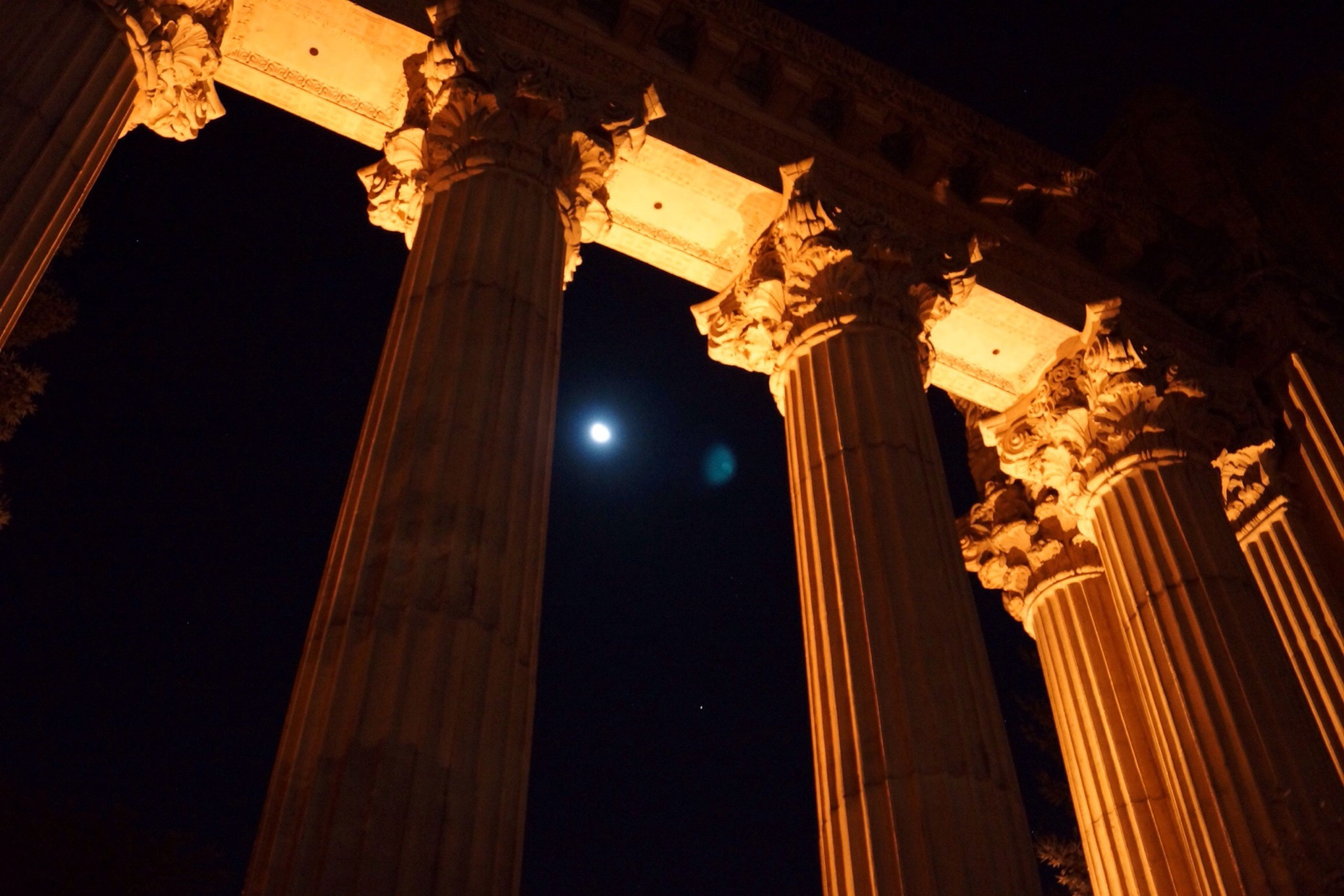 architecture, built structure, low angle view, night, architectural column, history, building exterior, column, religion, illuminated, old, famous place, travel destinations, arch, clear sky, place of worship, spirituality, sky, church