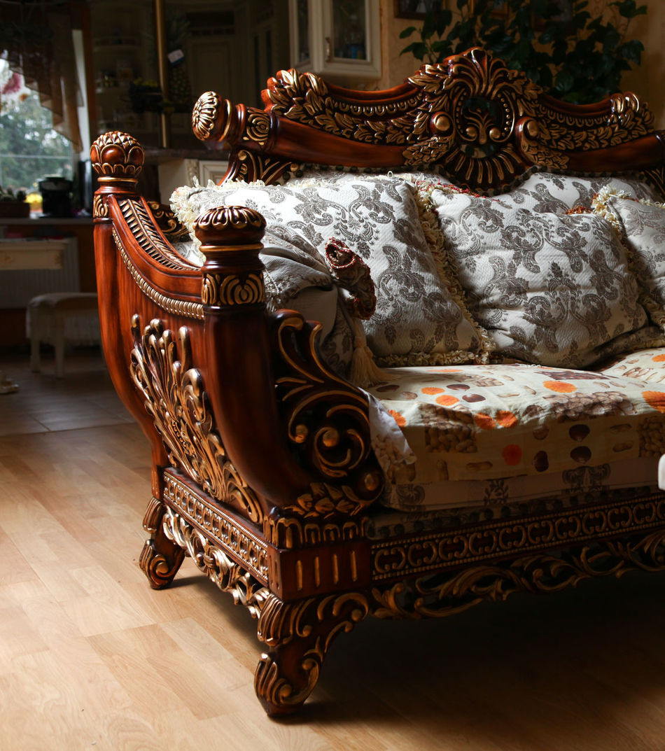 Carved antique luxury expensive sofa with cushions. Close up Antiques Baroque Carving Classic Close-up Couch Day Decoration Furniture Indoors  Luxury No People Old Ornate Pillow Revival Rococo Seat Sofa Wood