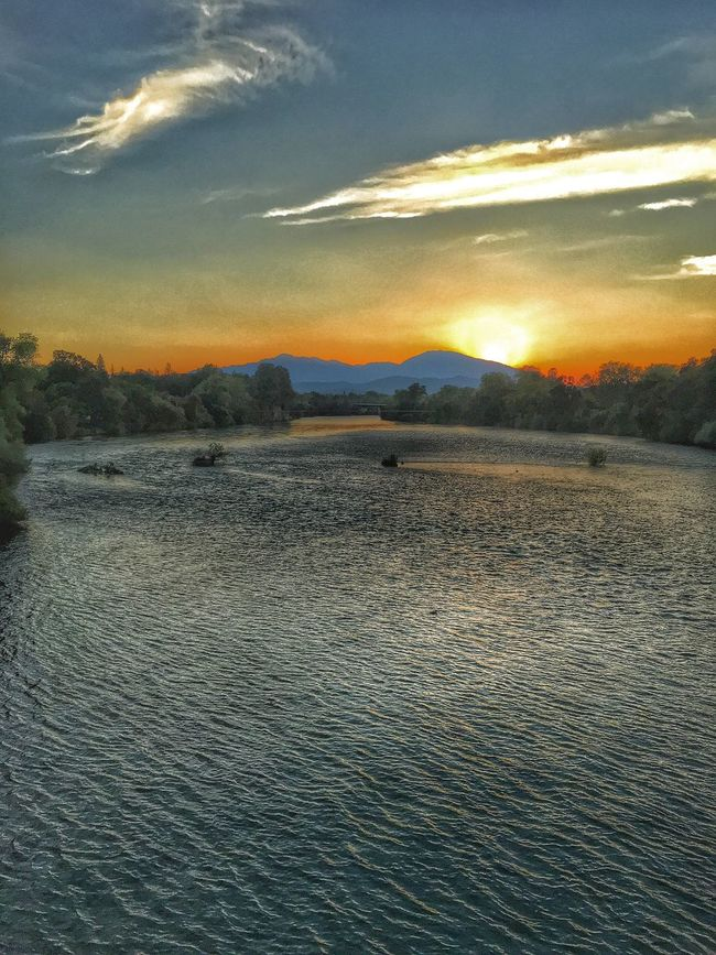 """The River"" Sunset Tranquil Scene Scenics Tranquility Beauty In Nature Water Sky Idyllic Cloud - Sky Nature Rippled Sea Cloud Waterfront Non-urban Scene Orange Color Remote Sun Calm Outdoors Redding California Northern California Sacramento River"