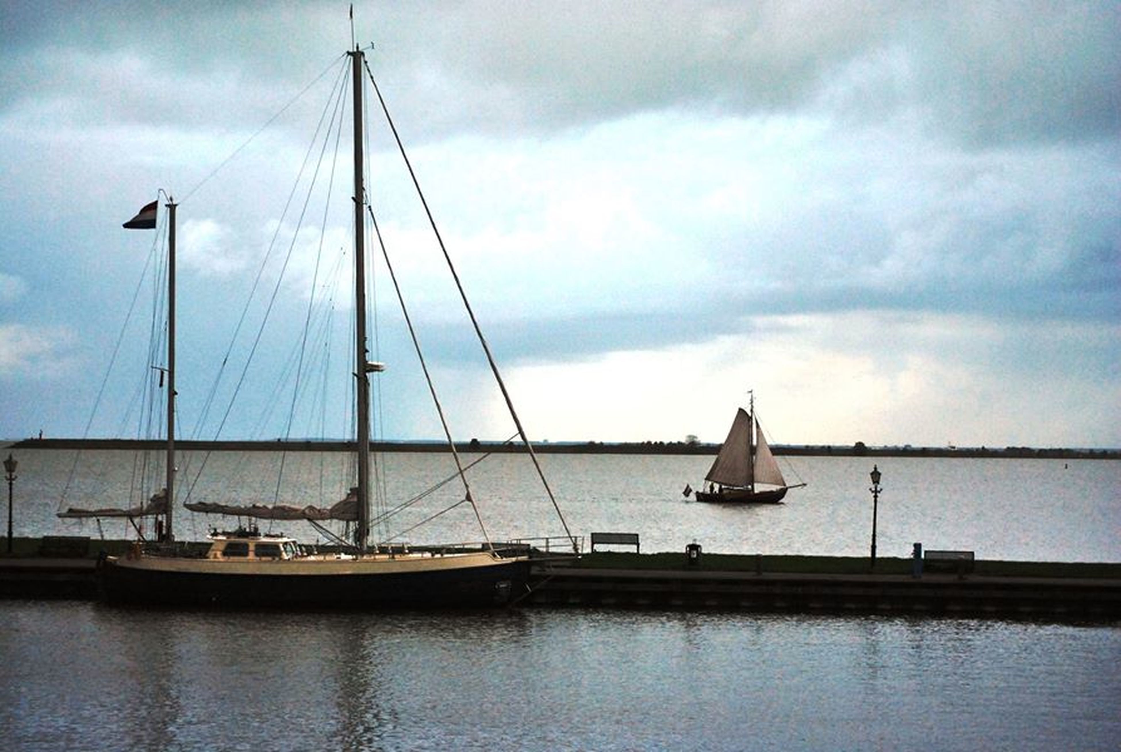 nautical vessel, transportation, mode of transport, boat, water, mast, moored, sky, sailboat, sea, cloud - sky, waterfront, sailing, cloudy, travel, cloud, journey, ship, day, nature