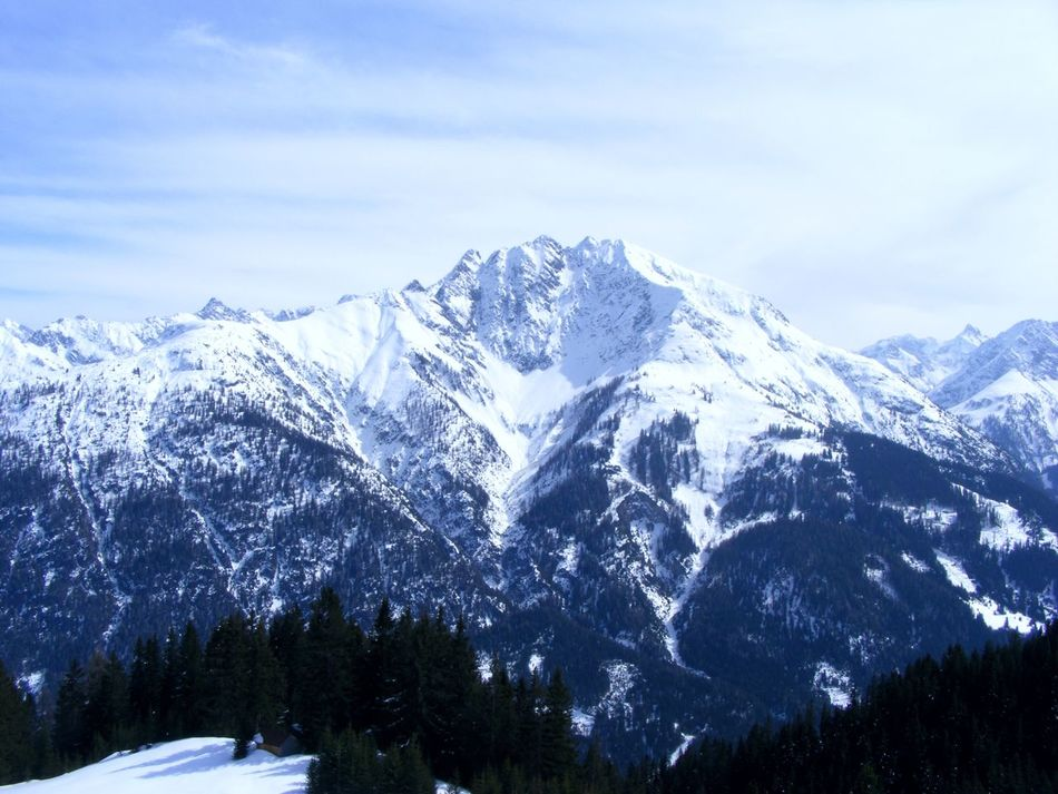view from the half of a mountain Beauty In Nature Cold Temperature Day Landscape Mountain Nature No People Outdoors Range Scenics Sky Snow Winter