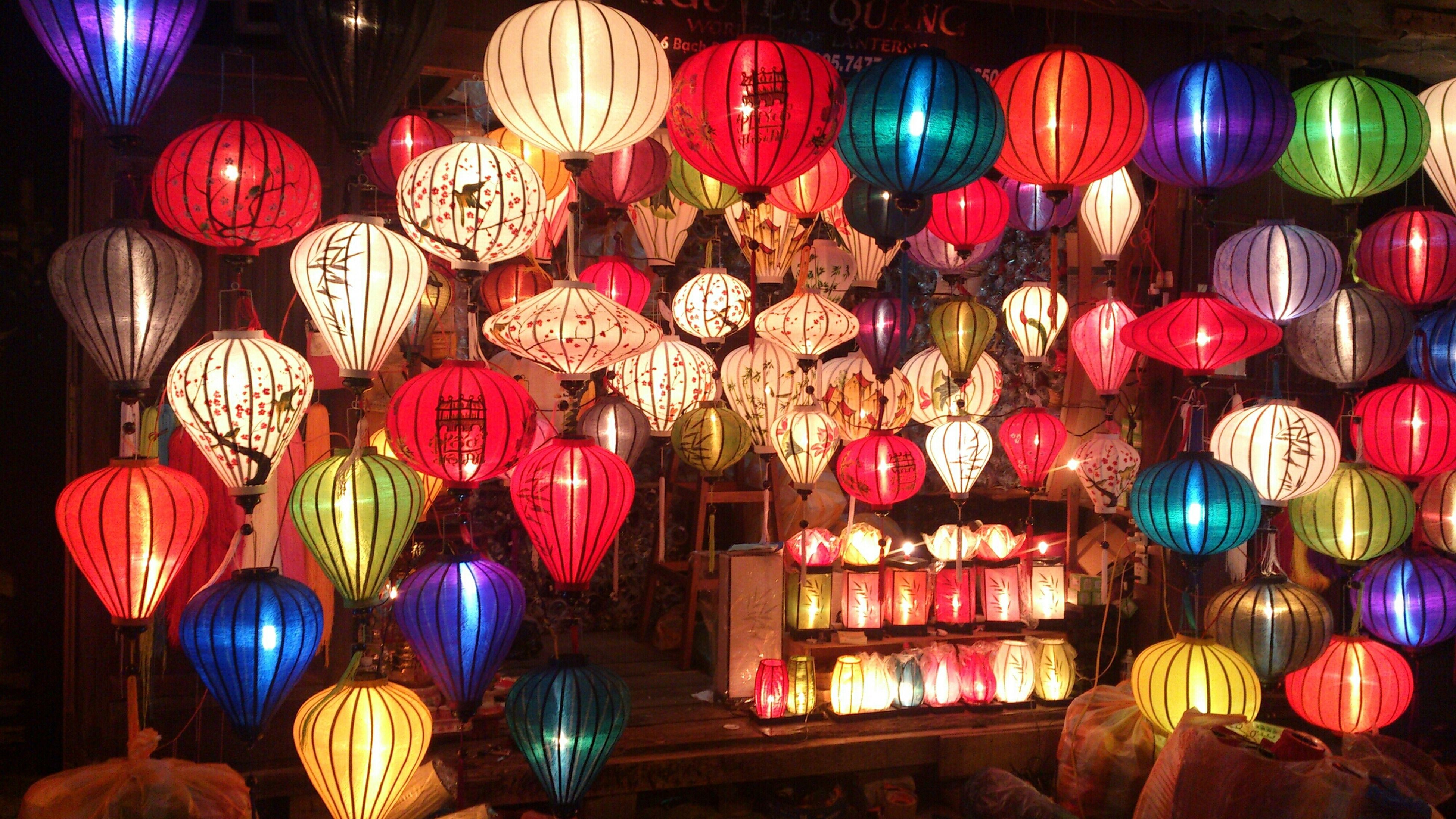 multi colored, large group of objects, variation, abundance, illuminated, choice, arrangement, decoration, in a row, lantern, colorful, indoors, hanging, cultures, night, for sale, tradition, lighting equipment, retail, celebration