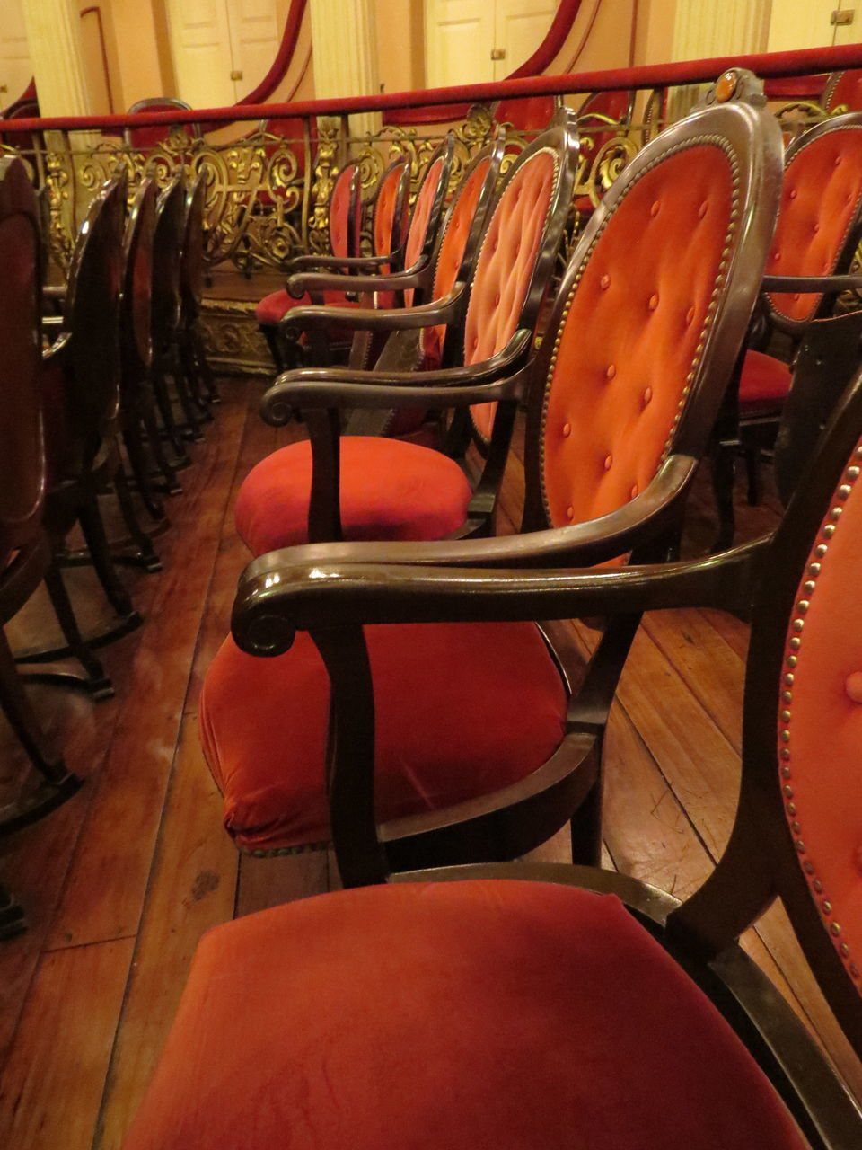chair, seat, in a row, empty, indoors, no people, wood - material, red, auditorium, day