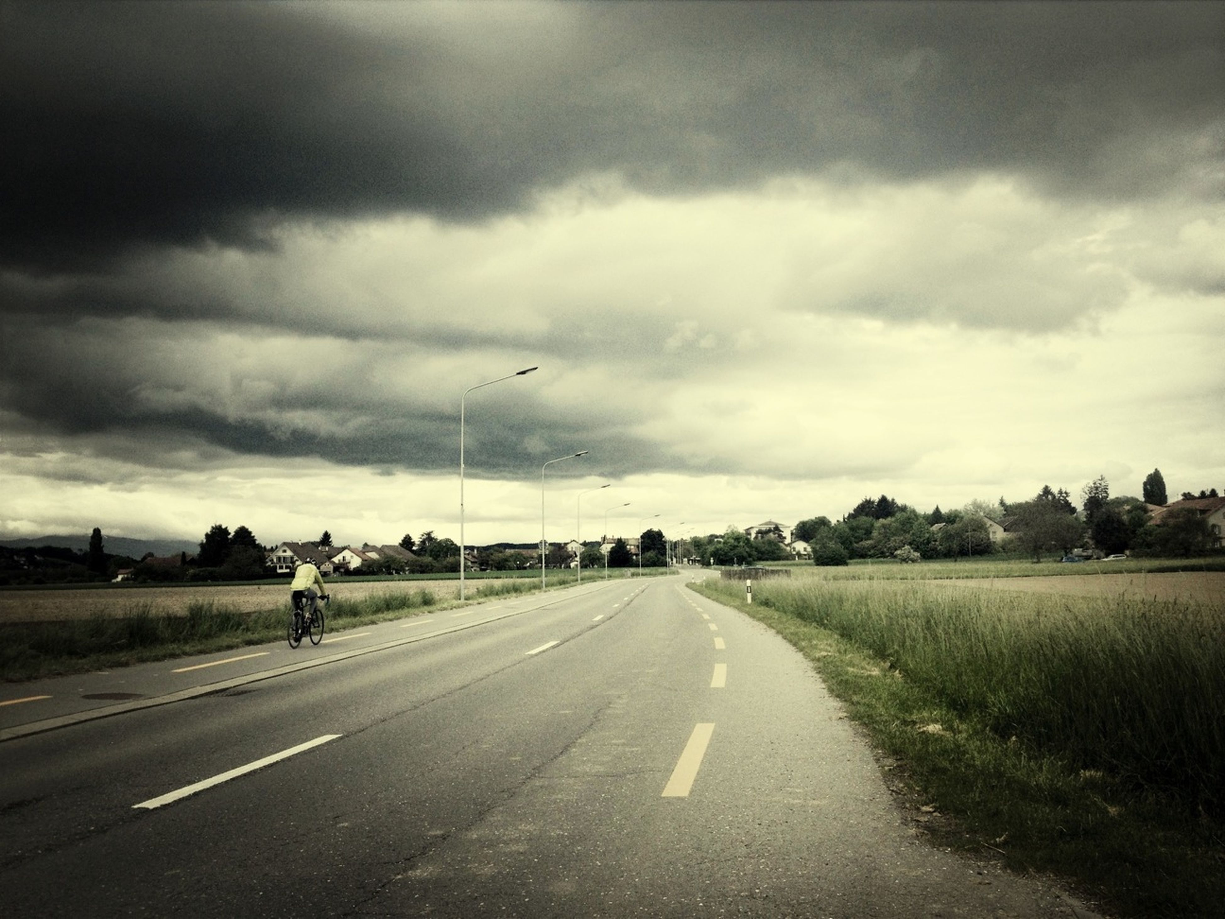 the way forward, road, transportation, sky, diminishing perspective, vanishing point, cloud - sky, cloudy, road marking, country road, street, empty road, empty, cloud, landscape, overcast, field, long, nature, asphalt