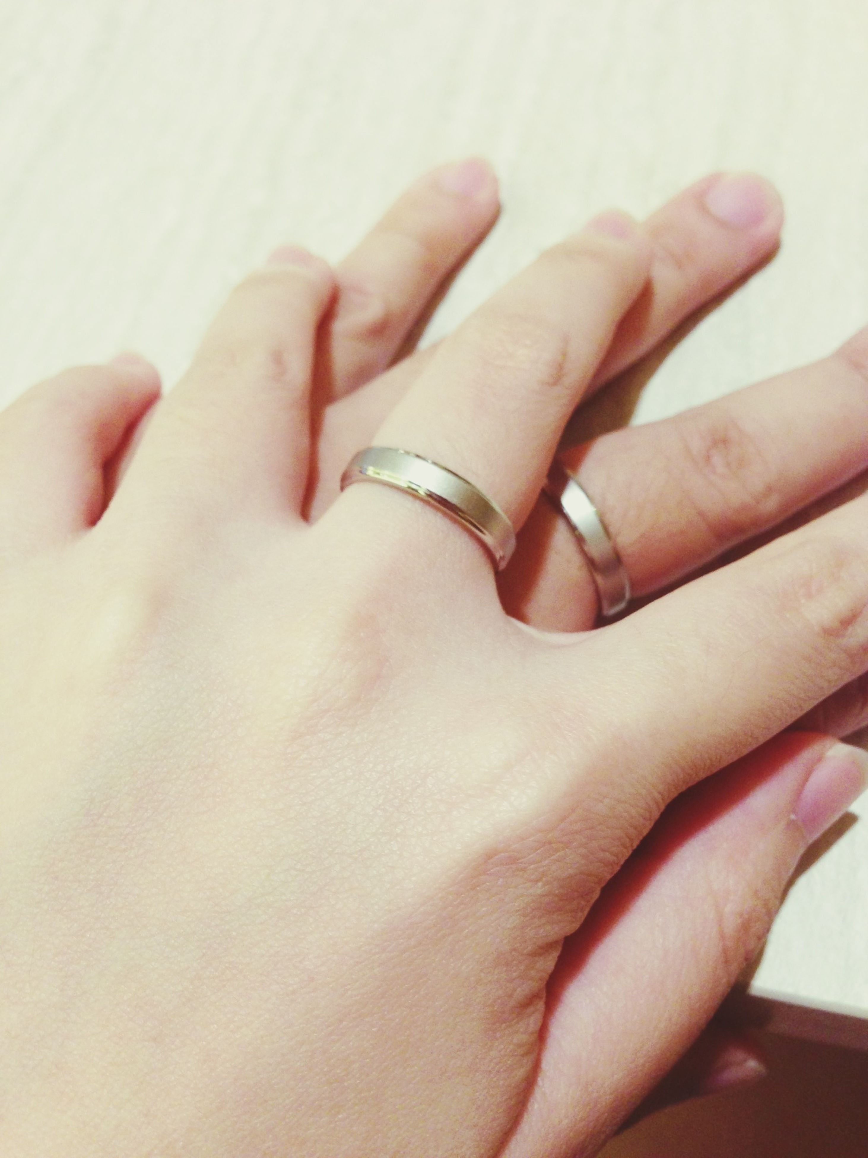 person, part of, human finger, cropped, indoors, close-up, holding, personal perspective, lifestyles, studio shot, unrecognizable person, human skin, palm, showing, ring, touching