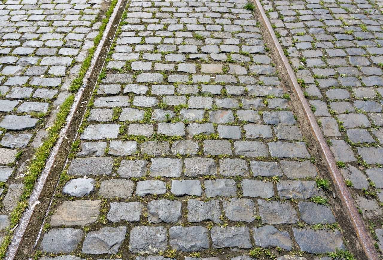 Discontinued Rail System Background Cobblestones Discontinued Industry Iron Lines Material No People Rails Steel Stones Street Text Tracks Train Tram