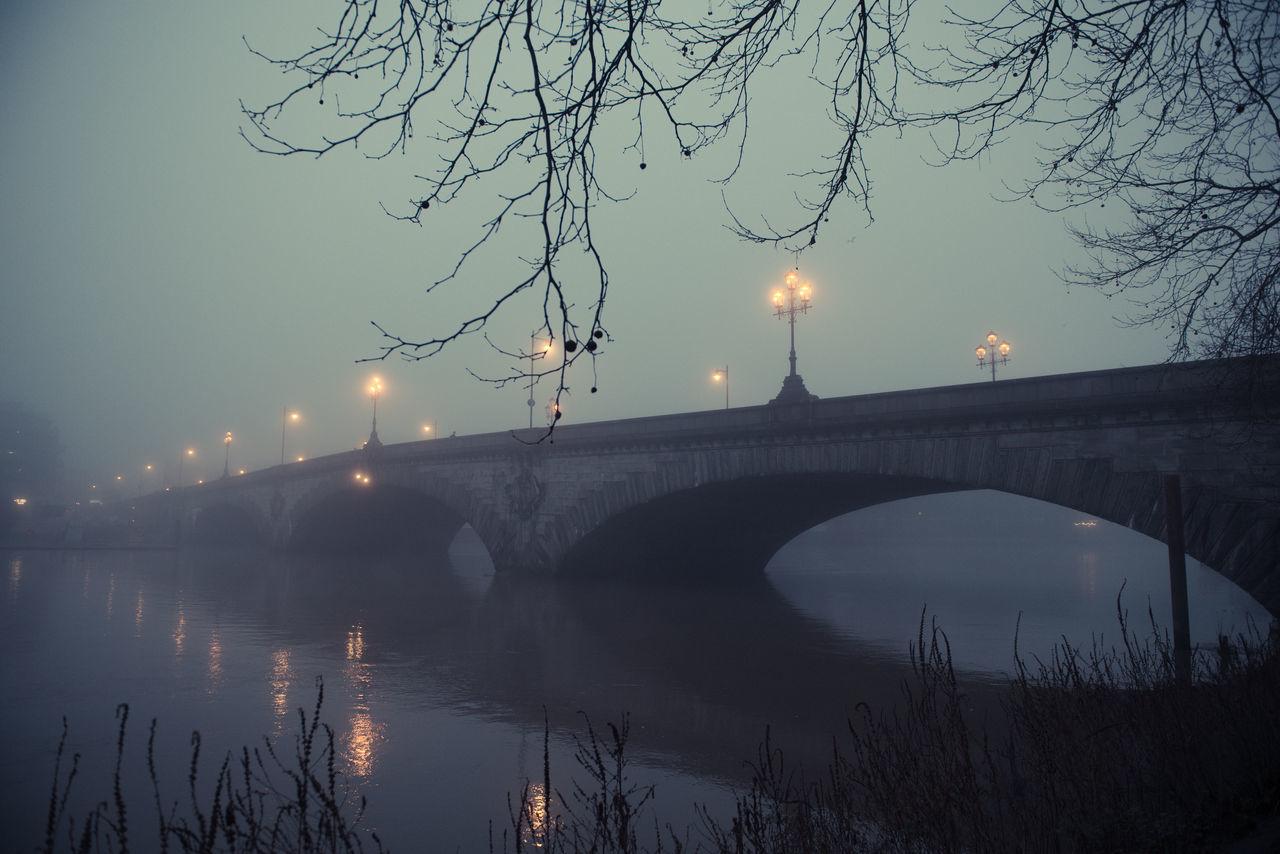 Bridge Bridge - Man Made Structure Fog Foggy Day Foggy Evening Gloomy Gloomy Weather Illuminated Kew Bridge London Outdoors Reflection River Street Light Thames Thames River Water
