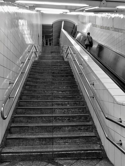 Architecture Berlin Black And White Blackandwhite Built Structure Day Illuminated Indoors  Kreuzberg Monochrome Monochrome Photography One Person Public Transportation Railing Railroad Station Railroad Station Platform Reflection Steps Steps And Staircases Steps And Stairs The Way Forward The Way Up Tiled Wall
