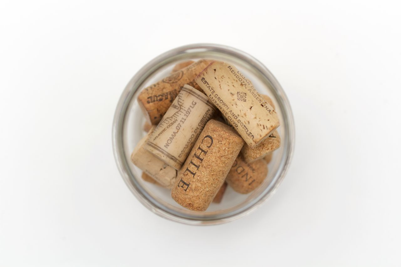 corks in a jar on white background Close-up Cork - Stopper Directly Above Drink High Angle View No People Studio Shot White Background Wine Cork