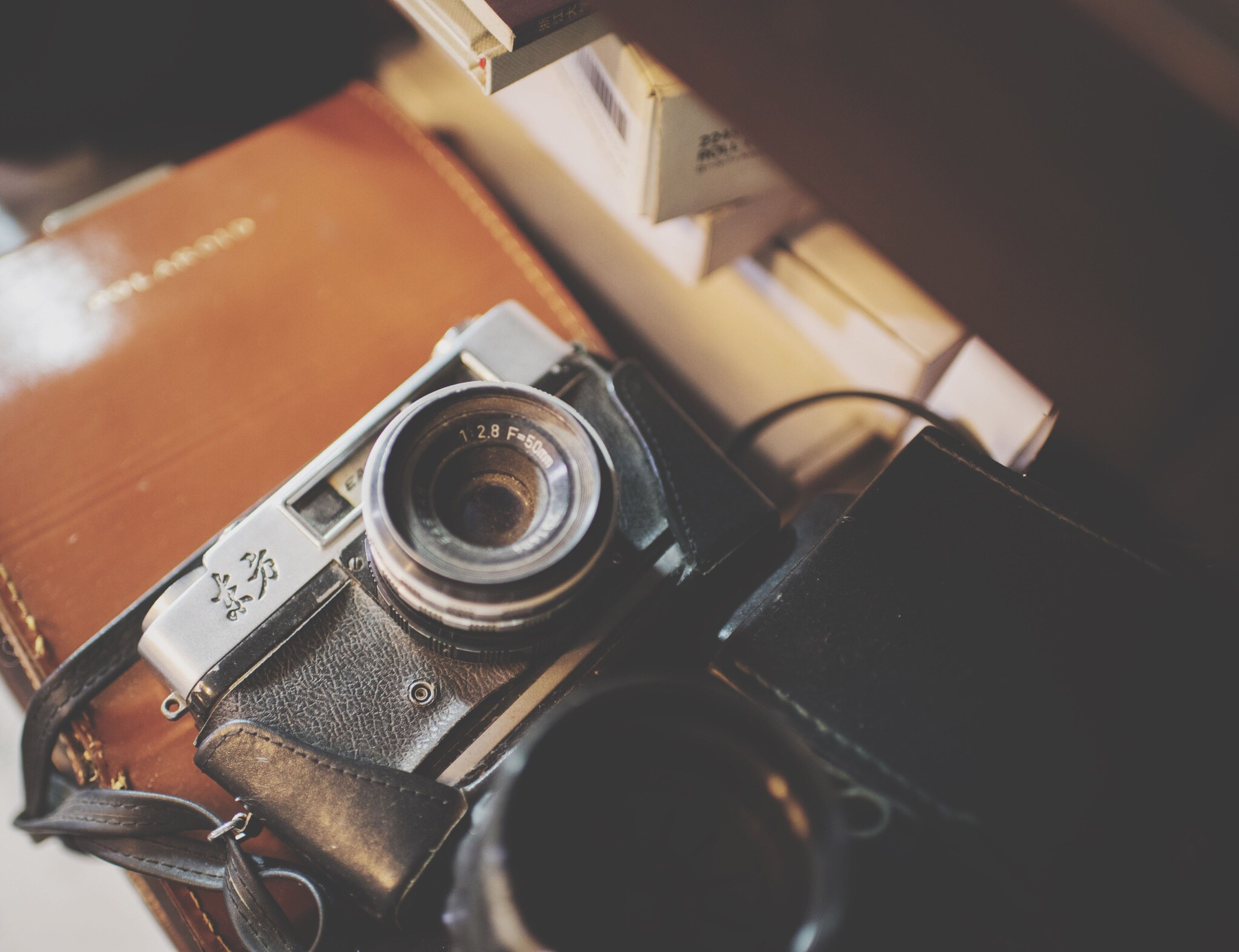 indoors, close-up, technology, metal, old-fashioned, retro styled, photography themes, focus on foreground, music, selective focus, camera - photographic equipment, still life, equipment, no people, connection, part of, arts culture and entertainment, old, high angle view, machine part