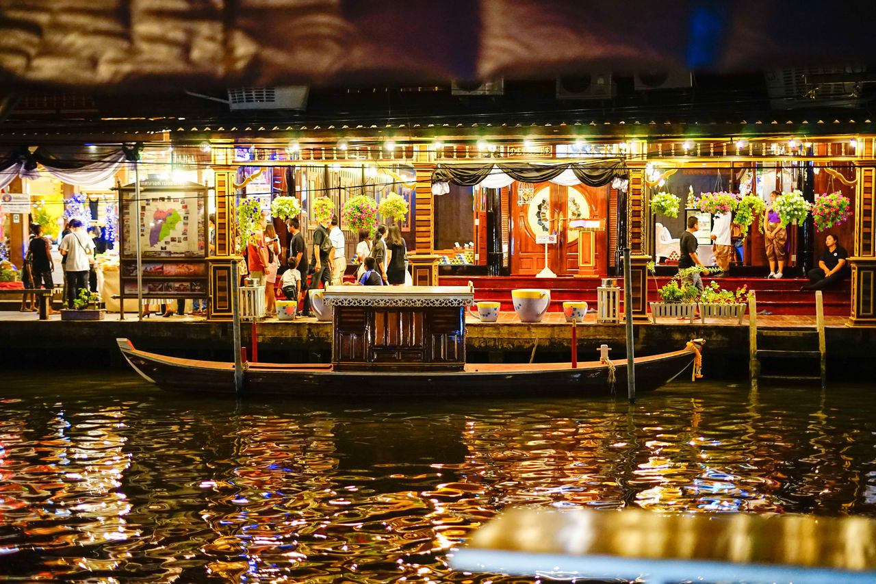 illuminated, night, real people, nautical vessel, outdoors, large group of people, building exterior, men, architecture, carousel, people