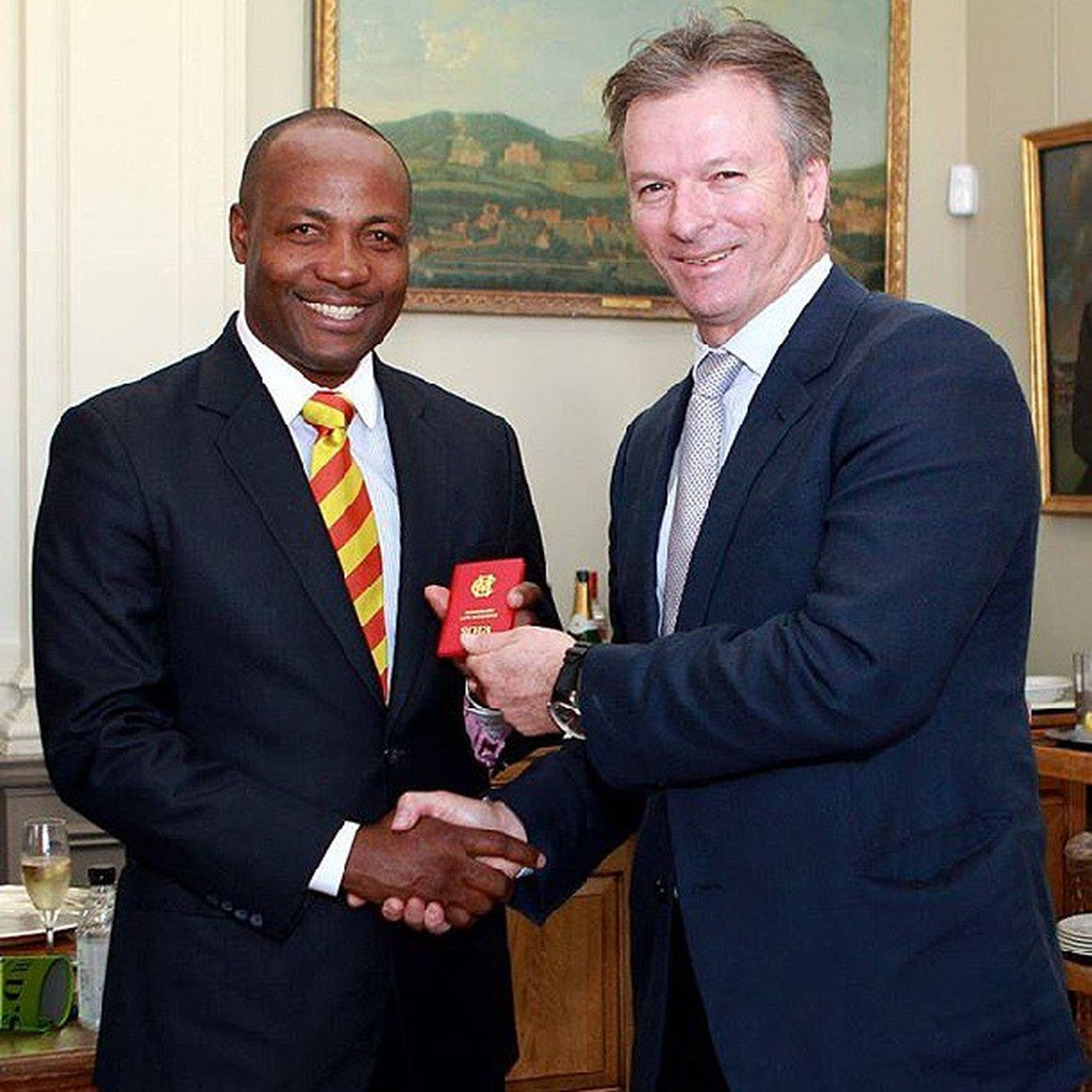 Mcc  @CricketAus have just made @BrianLara @westindies an MCCHonoraryLifeMember of the Club and here is SteveWaugh presenting him with the little red book. — with BrianLara at Lord's CricketGround.