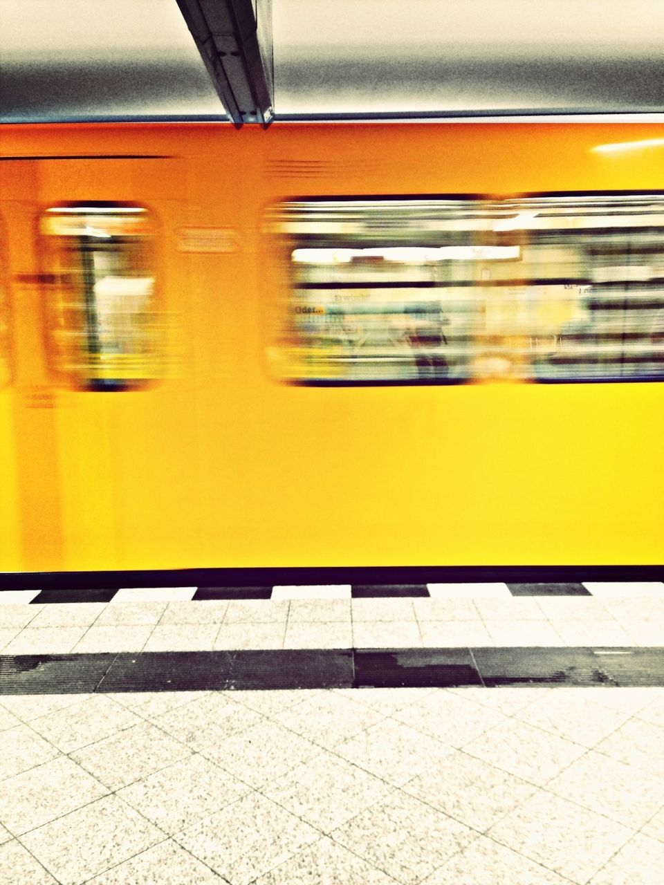 transportation, train - vehicle, public transportation, railroad station platform, blurred motion, rail transportation, speed, railroad station, subway train, mode of transport, passenger train, motion, metro train, yellow, indoors, no people, day
