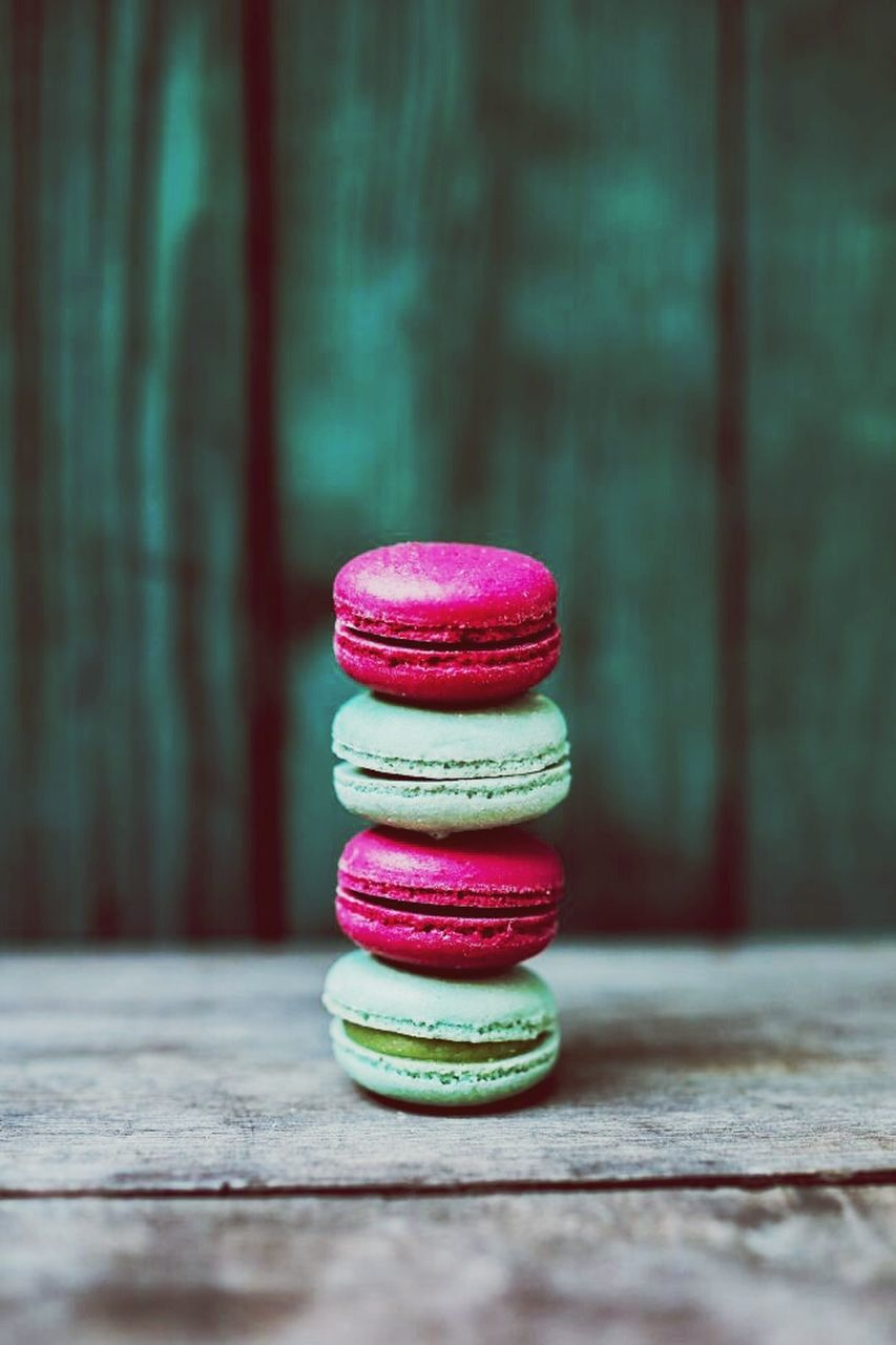 wood - material, stack, macaroon, no people, food and drink, table, focus on foreground, multi colored, indoors, sweet food, close-up, day, freshness