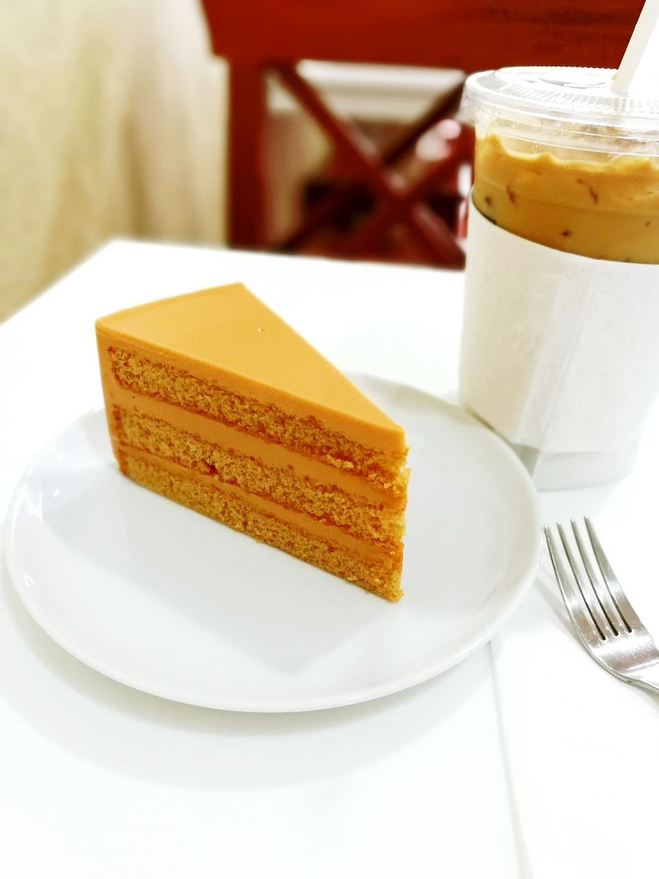 Thai Tea Cake with cold coffee for relax time. Cake Tea Thai Cake Time Coffee Break Coffee - Drink Coffeelovers Relax Relaxation Relaxing Time Relax Time  Relaxedand Happy Dessert Bakery Cafe Bakery Bakery Cake