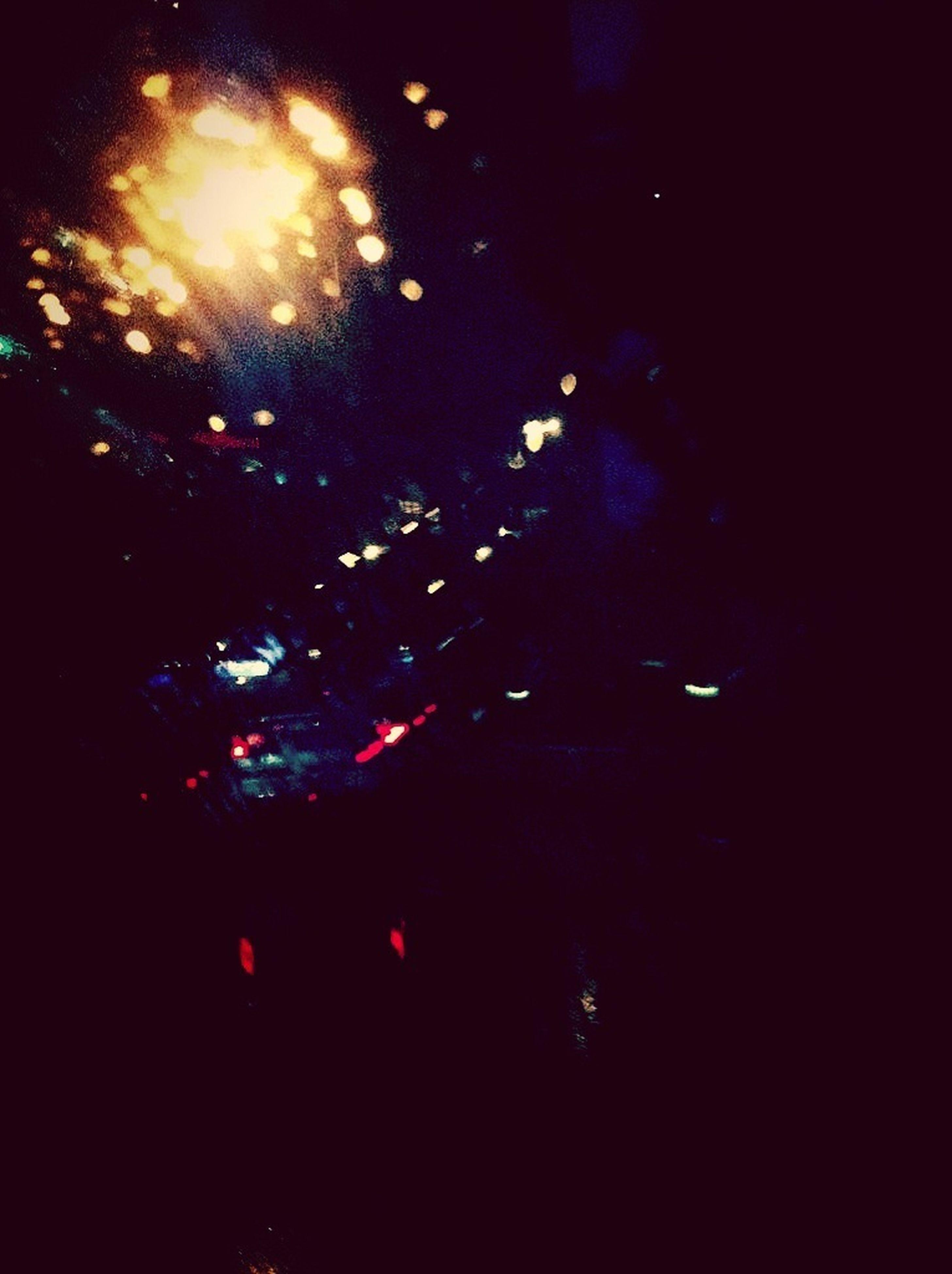 night, illuminated, dark, light - natural phenomenon, lighting equipment, glowing, indoors, car, street, no people, celebration, glass - material, motion, transparent, street light, light, multi colored, nightlife, window