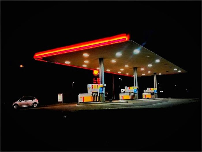 Fuel Pump Gasoline Refueling Fossil Fuel Gas Station Fuel And Power Generation Illuminated Transportation Night Car Oil Industry No People Neon Land Vehicle Built Structure Outdoors Industry Oil Pump