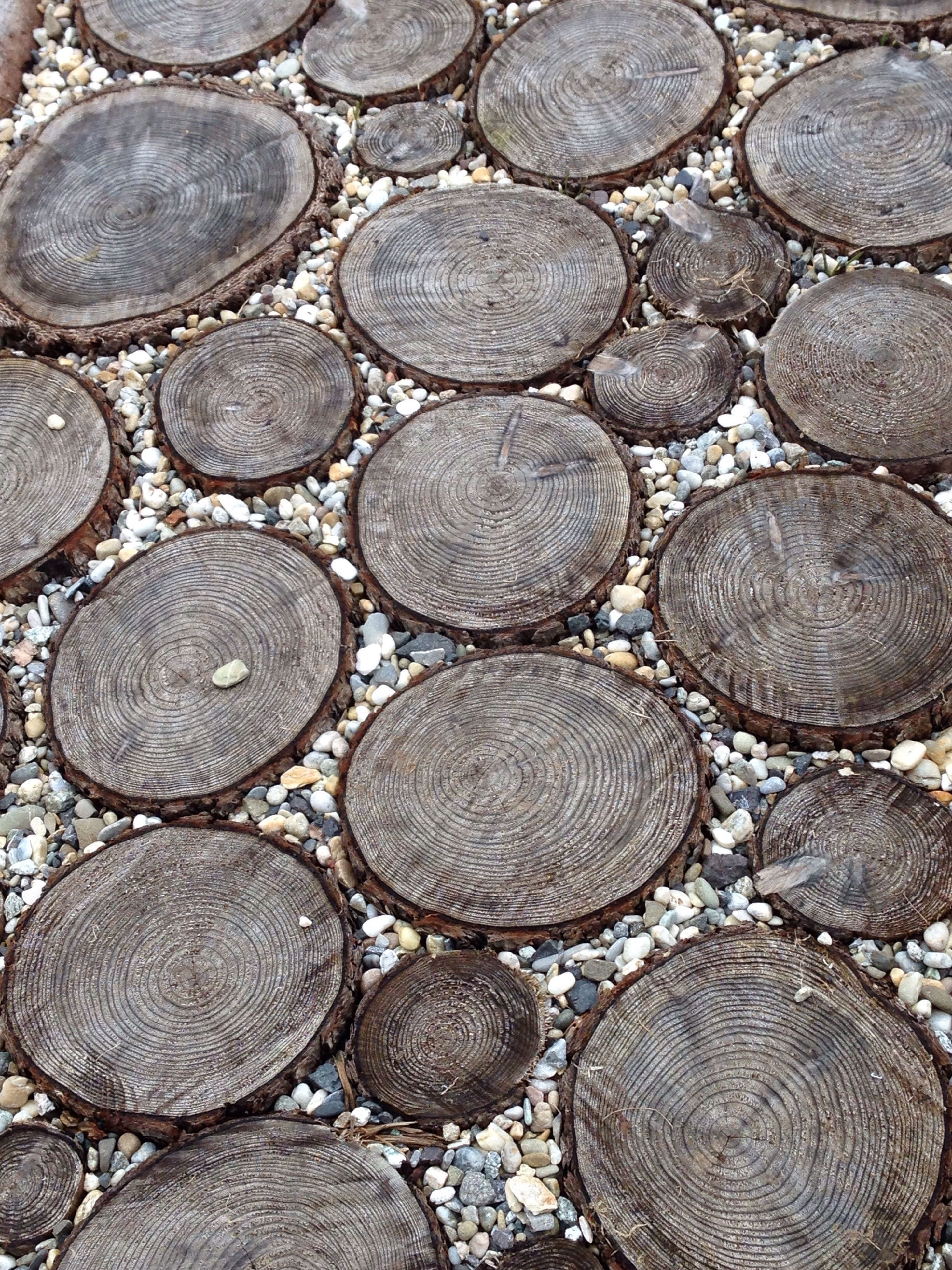 full frame, backgrounds, pattern, abundance, textured, large group of objects, circle, high angle view, close-up, repetition, design, stone - object, cobblestone, no people, outdoors, geometric shape, stack, shape, day, detail