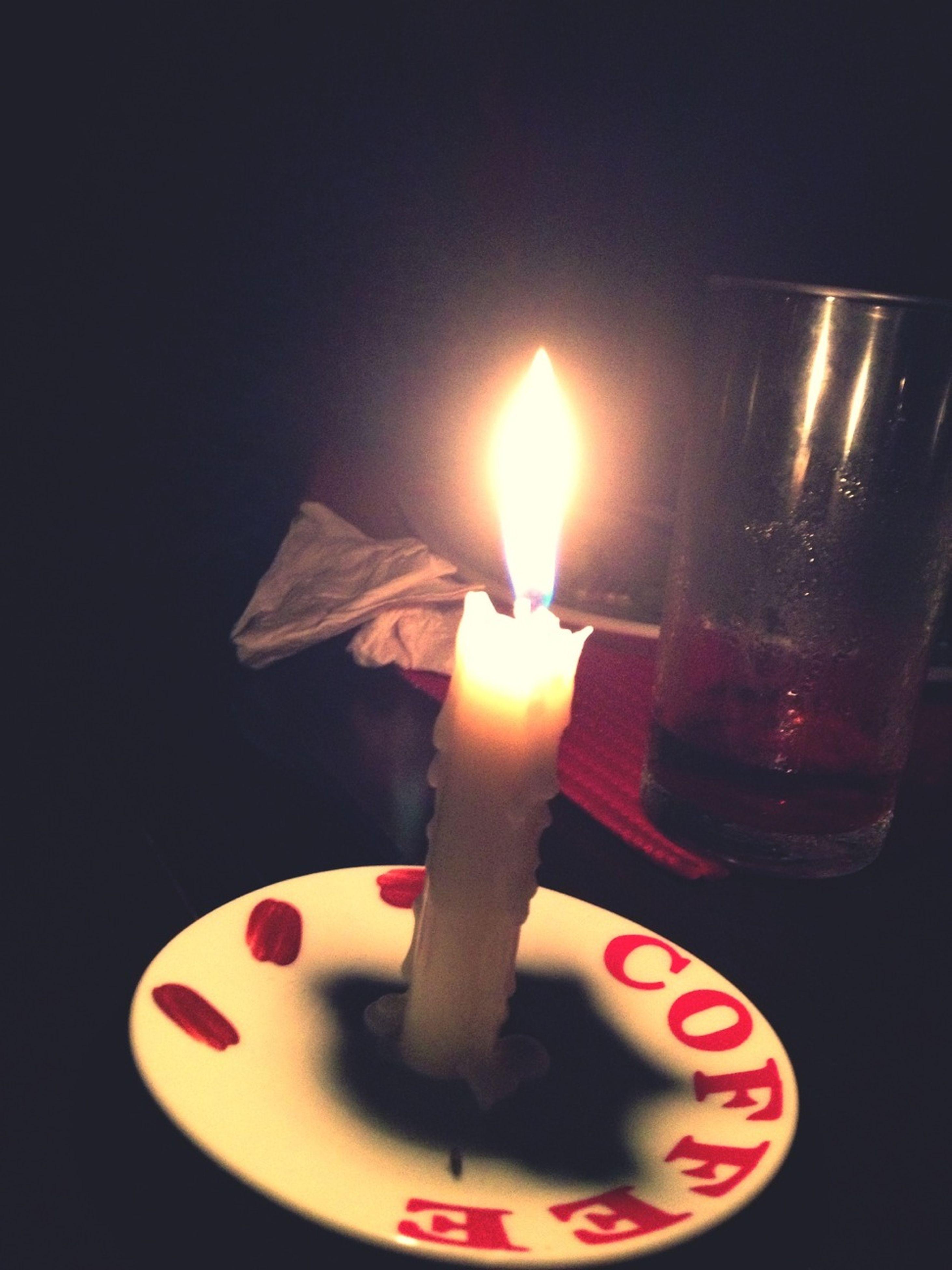 candle, indoors, flame, burning, illuminated, close-up, glowing, heat - temperature, lit, candlelight, fire - natural phenomenon, studio shot, still life, tea light, lighting equipment, black background, darkroom, single object, dark, fire