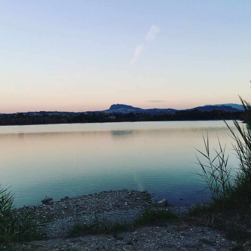 Tranquil Scene Tranquility Nature Water Scenics Reflection Beauty In Nature Lake Sunset Sky No People Outdoors Silhouette Mountain Landscape Clear Sky Day