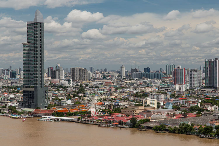 Bangkok City Cloudy Riverside Architecture Bangkok Sky Bird Perspective Building Exterior Built Structure City Cityscape Cloud - Sky Clouds And Sky Day First Eyeem Photo No People River Sky Skyline Skyscraper Top Perspective Top View Travel Destinations Urban Skyline Water Waterfront