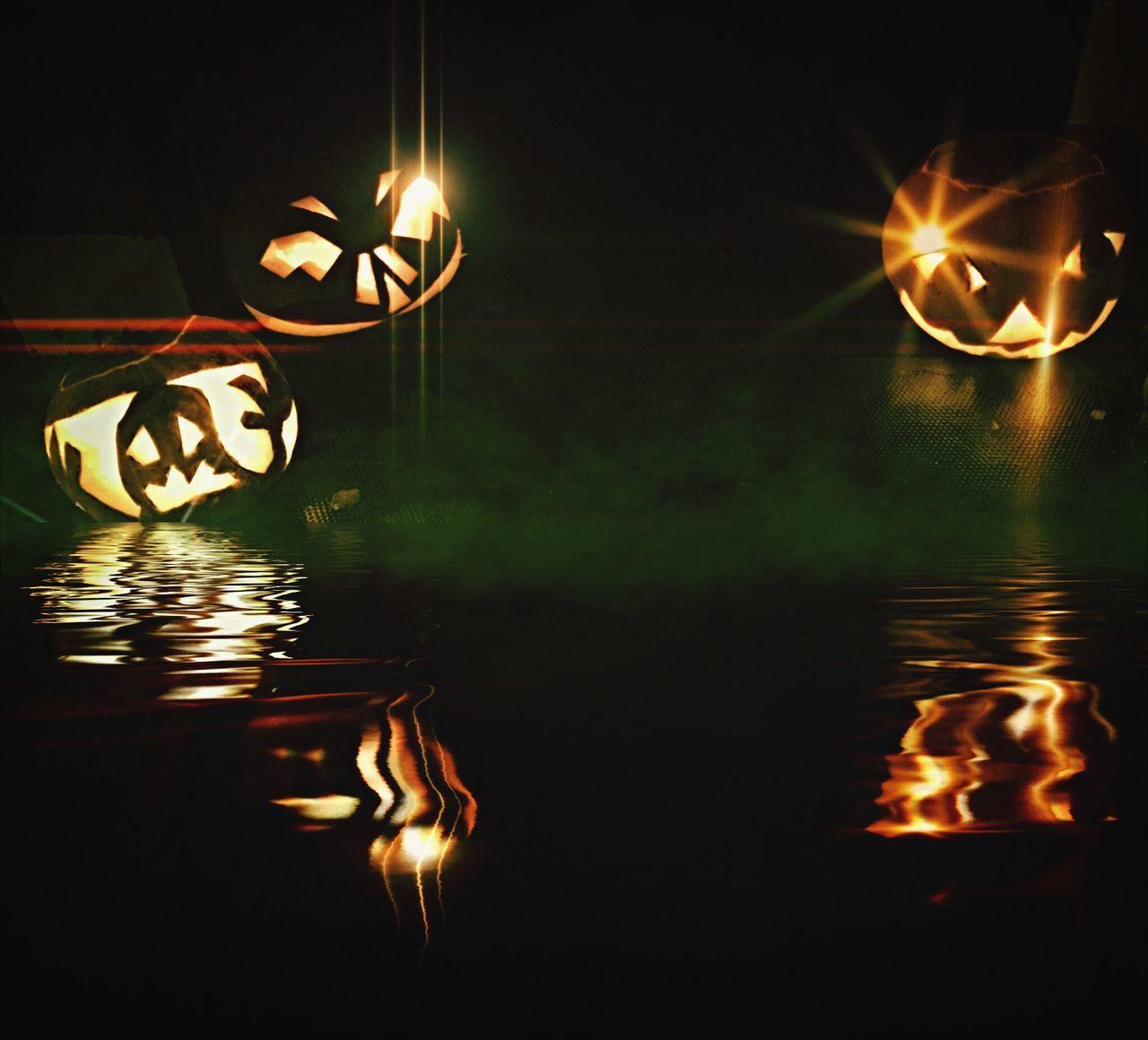 Illuminated Halloween Lantern Over Lake