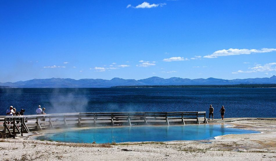 Beauty In Nature Blue Hotspring Idyllic Mountain Range Nature Outdoors Scenics Sky Tourism Tranquil Scene Tranquility Travel Destinations Water Yellowstone Lake Yellowstone National Park