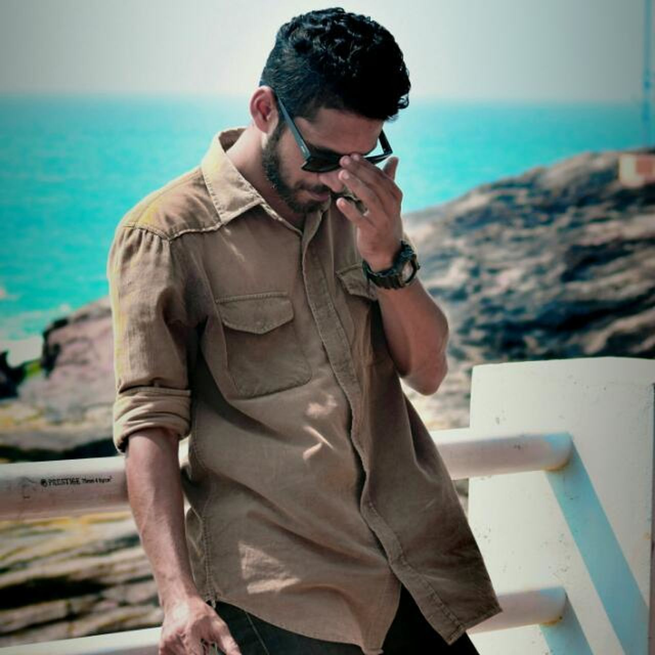When My friend posed... Only Men One Man Only Sea Casual Clothing Lifestyles Beach Men Water Outdoors Day Calmness Ray Of Sun Kerala The Gods Own Country ;) Friendship Beard One Mature Man Only Sunglases 😎 Shades Of Light Model Mode Model Photography