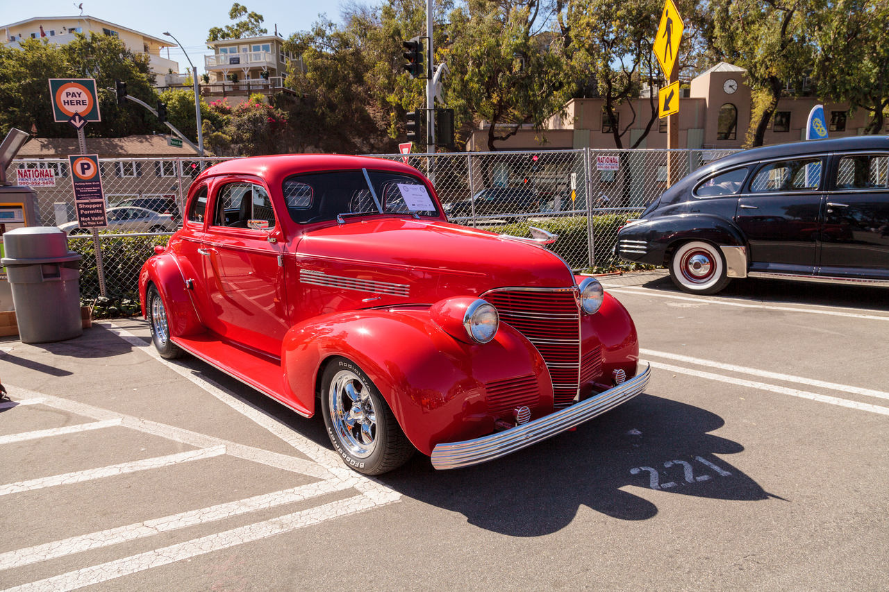 Laguna Beach, CA, USA - October 2, 2016: Red 1939 Chevy Coupe owned by Ken Biggs and displayed at the Rotary Club of Laguna Beach 2016 Classic Car Show. Editorial use. 1939 Auto Racing Car Car Show Chevrolet Chevy Chevy Coupe Classic Car Classic Car Show Day Driving Laguna Beach, CA Land Vehicle Motorsport No People Old Car Old-fashioned Outdoors Racecar Red Road Sports Race Transportation Vintage Cars