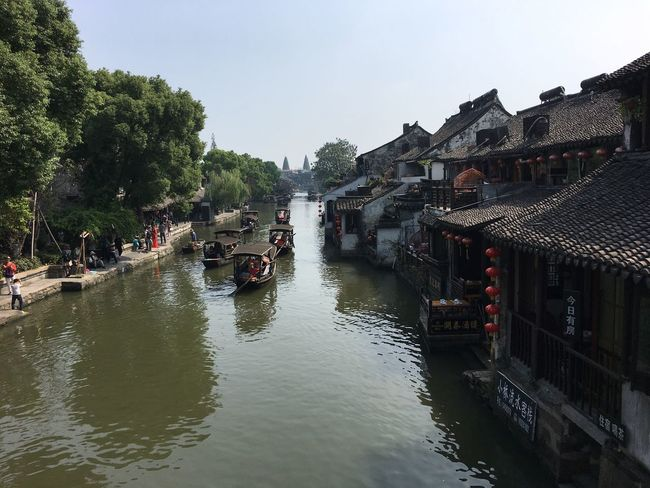 Watertown China Xitang Fresh On Eyeem  Water Nautical Vessel Transportation Tree Architecture Boat Waterfront Built Structure River Building Exterior Canal Mode Of Transport Moored Clear Sky Riverbank Day Sky Diminishing Perspective City Life Town