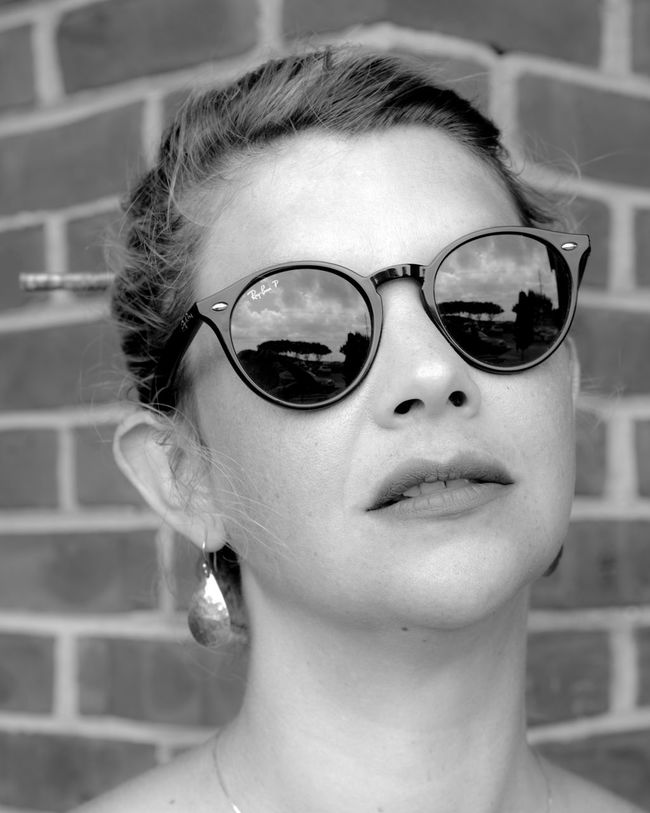 Black And White Photography Brick And Mortar Brick Wall Casual Clothing Close-up Cute Day Focus On Foreground Front View Headshot Human Face Leisure Activity Lifestyles Portrait Sunglasses Woman Portrait Of A Woman Pretty Girl Smiling Beauty Film Noir Pregnancy Pregnancy Photography