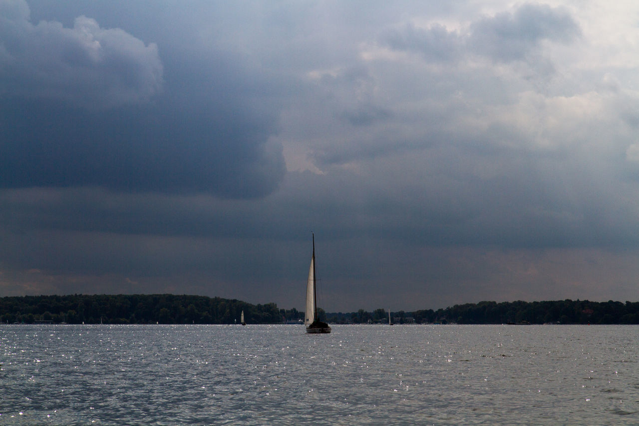 Atmospheric Mood Beauty In Nature Boat Calm Cloud Cloud - Sky Cloudy Journey Mid Distance Mode Of Transport Nature Nautical Vessel Ocean Outdoors Rippled Sailboat Scenics Sea Seascape Sky Tranquil Scene Tranquility Transportation Water Waterfront