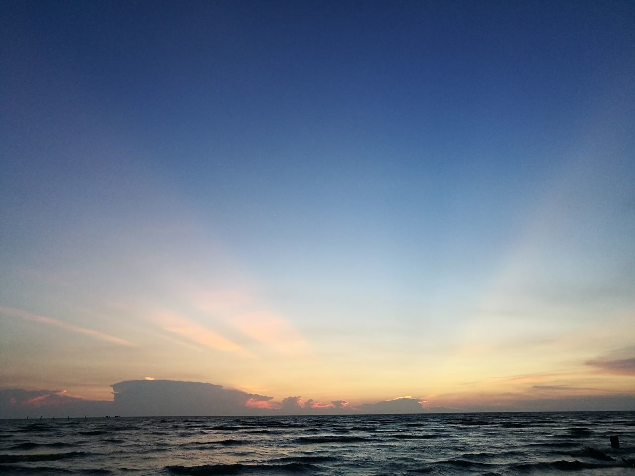 sea, sunset, scenics, sky, beauty in nature, nature, tranquil scene, tranquility, horizon over water, water, beach, outdoors, no people, silhouette, blue, clear sky, day